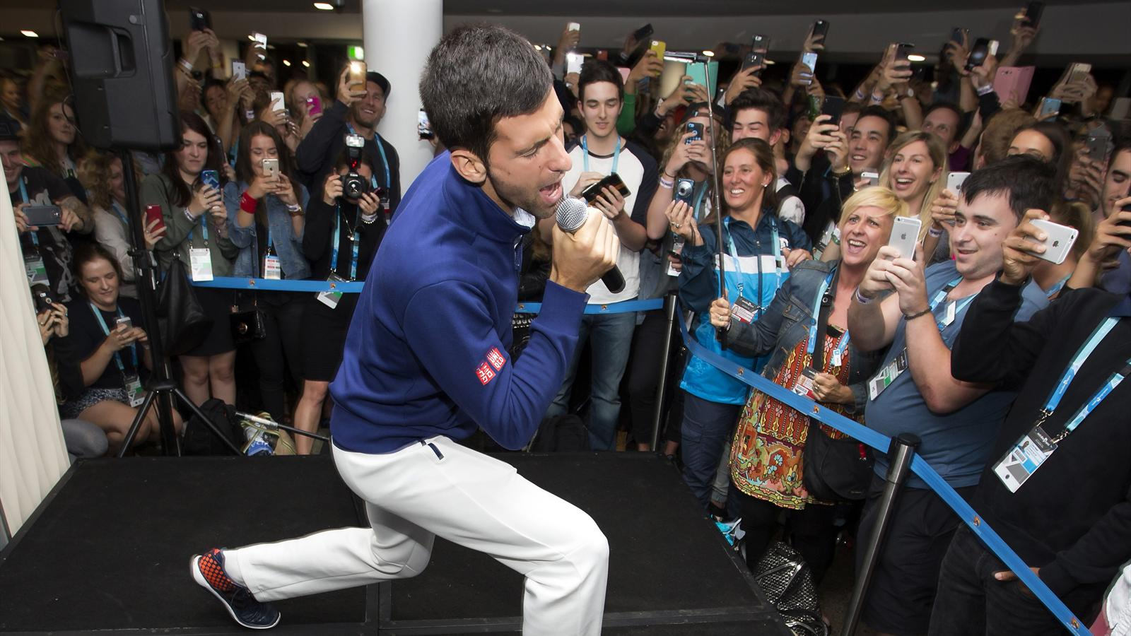 Serbia's Novak Djokovic sings during a party for Melbourne Park staff after winning his final match against Britain's Andy Murray at the Australian Open