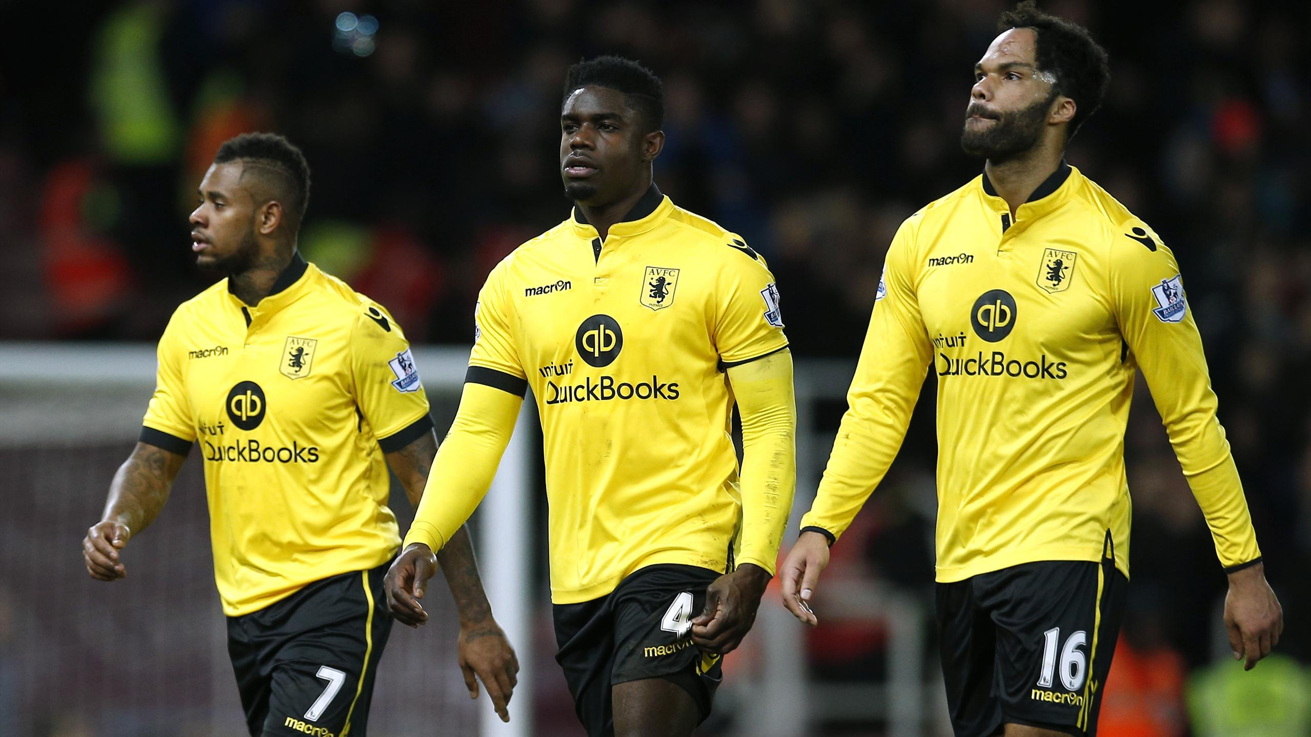 Aston Villa's Joleon Lescott (R), Micah Richards (C) and Leandro Bacuna look dejected at the end of the match