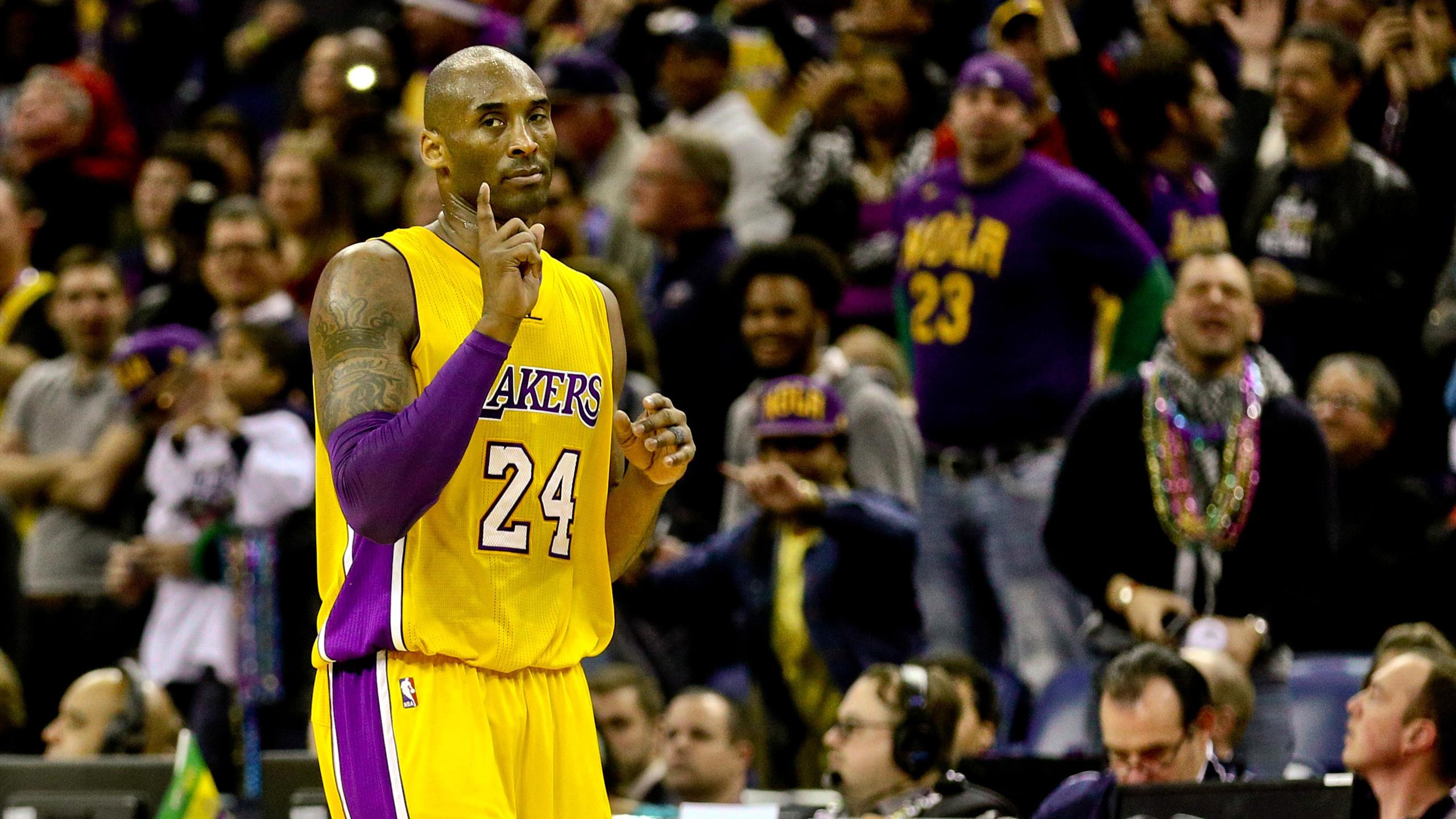 Los Angeles Lakers forward Kobe Bryant (24) gestures after scoring against the New Orleans Pelicans during the fourth quarter of a game at the Smoothie King Center