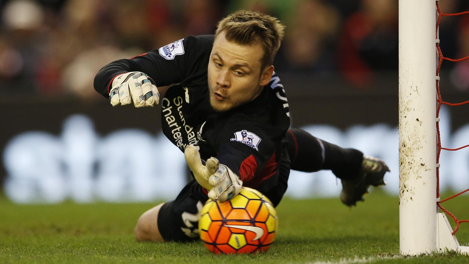 Adam Johnson's free-kick slips under the hands of Liverpool goalkeeper Simon Mignolet