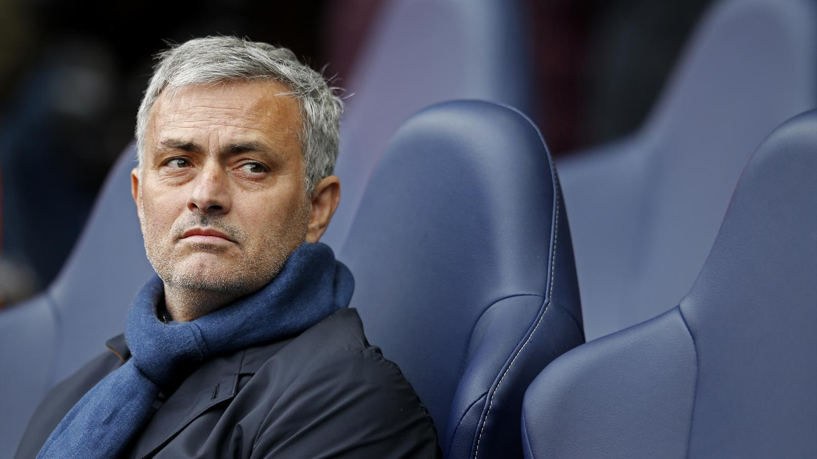 Jose Mourinho sits on the bench at Chelsea