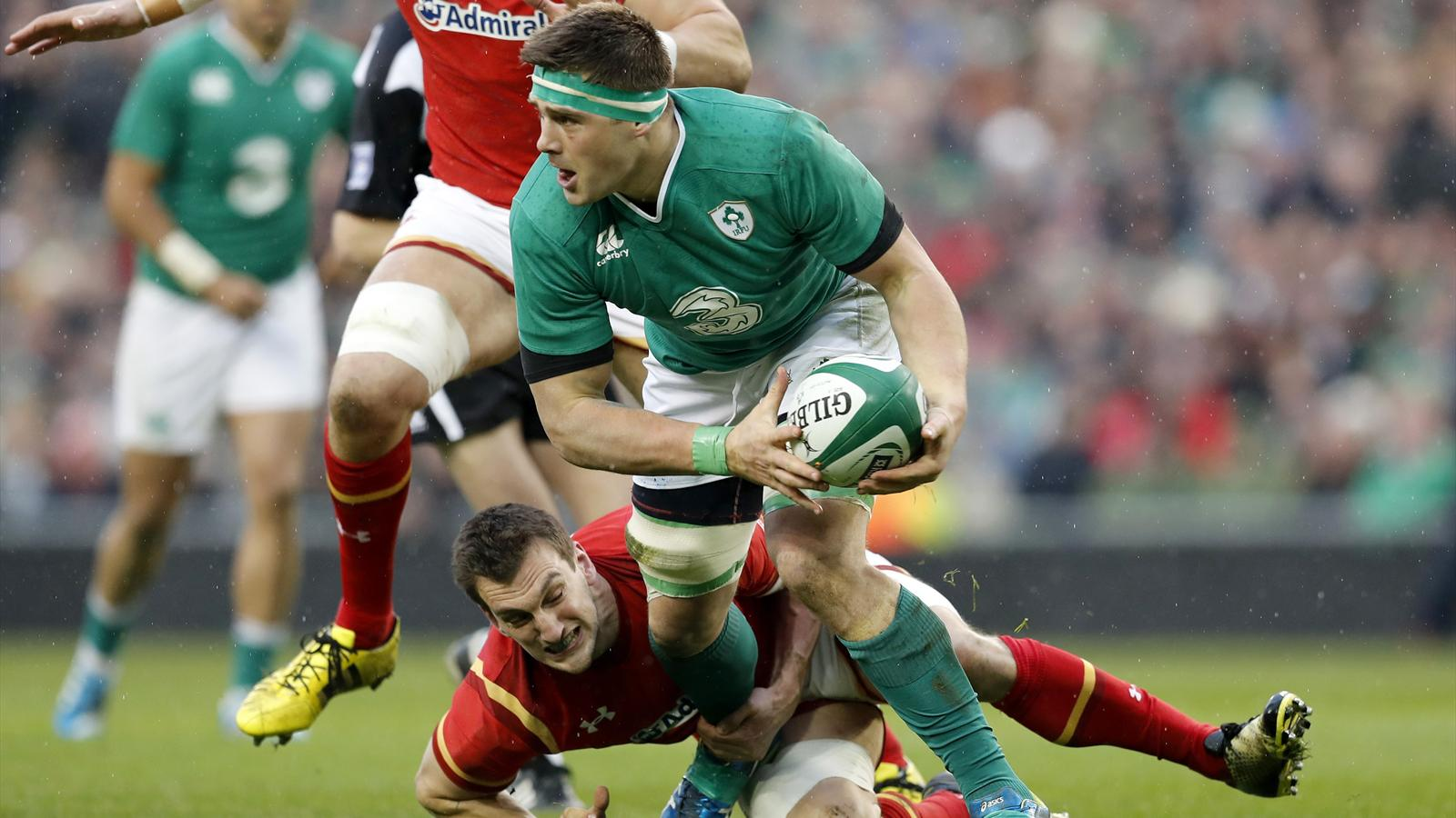 Wales' Sam Warburton tackles Ireland's CJ Stander