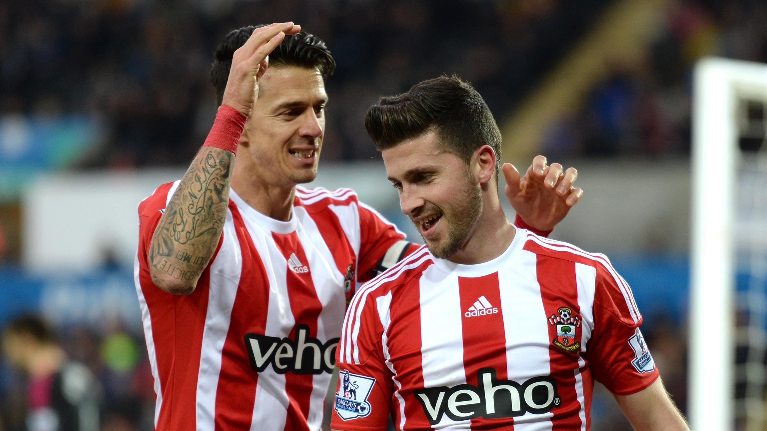 Shane Long celebrates with Jose Fonte (L) after scoring the first goal for Southampton