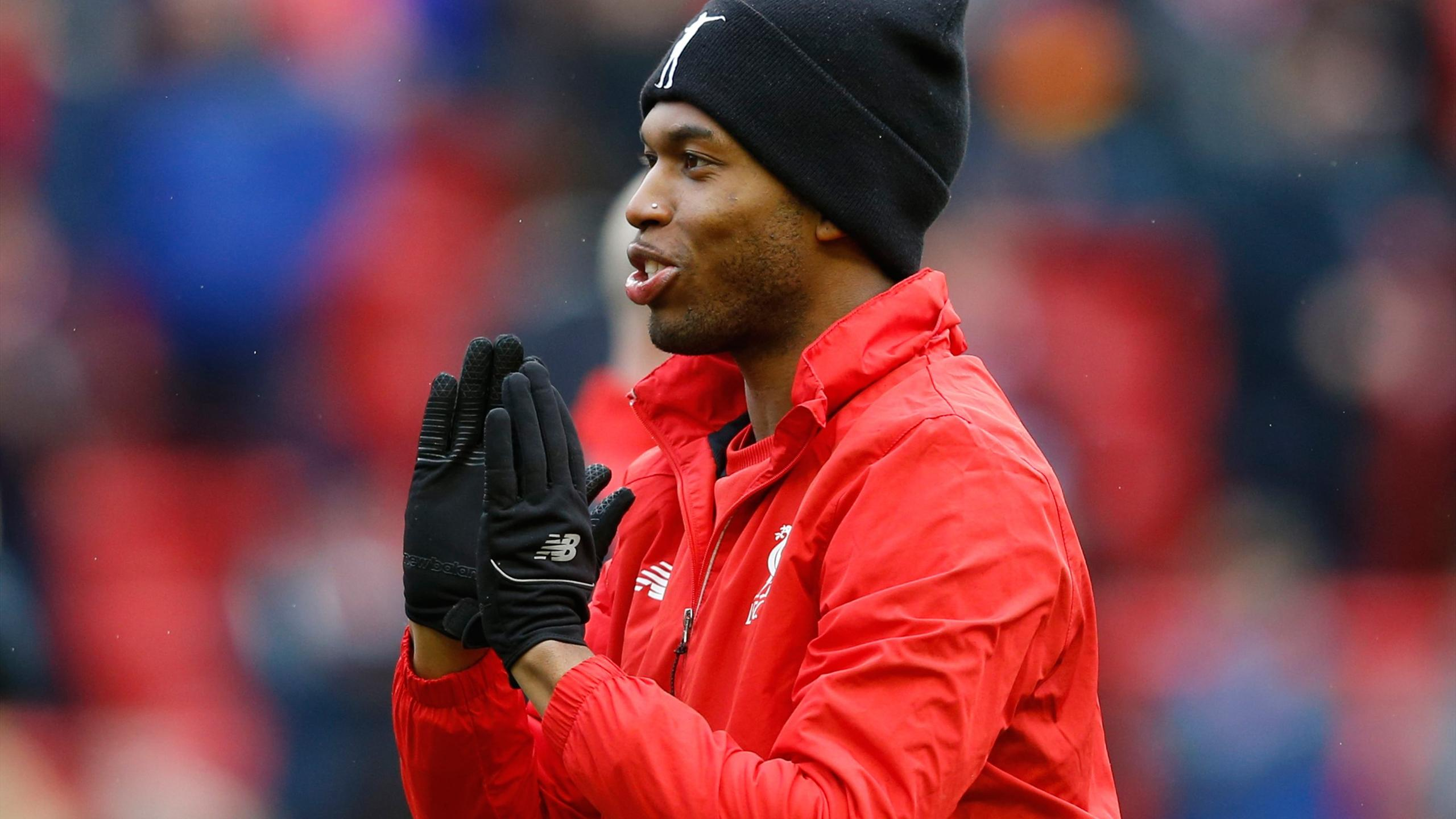 Liverpool's Daniel Sturridge wearing his own branded beanie hat