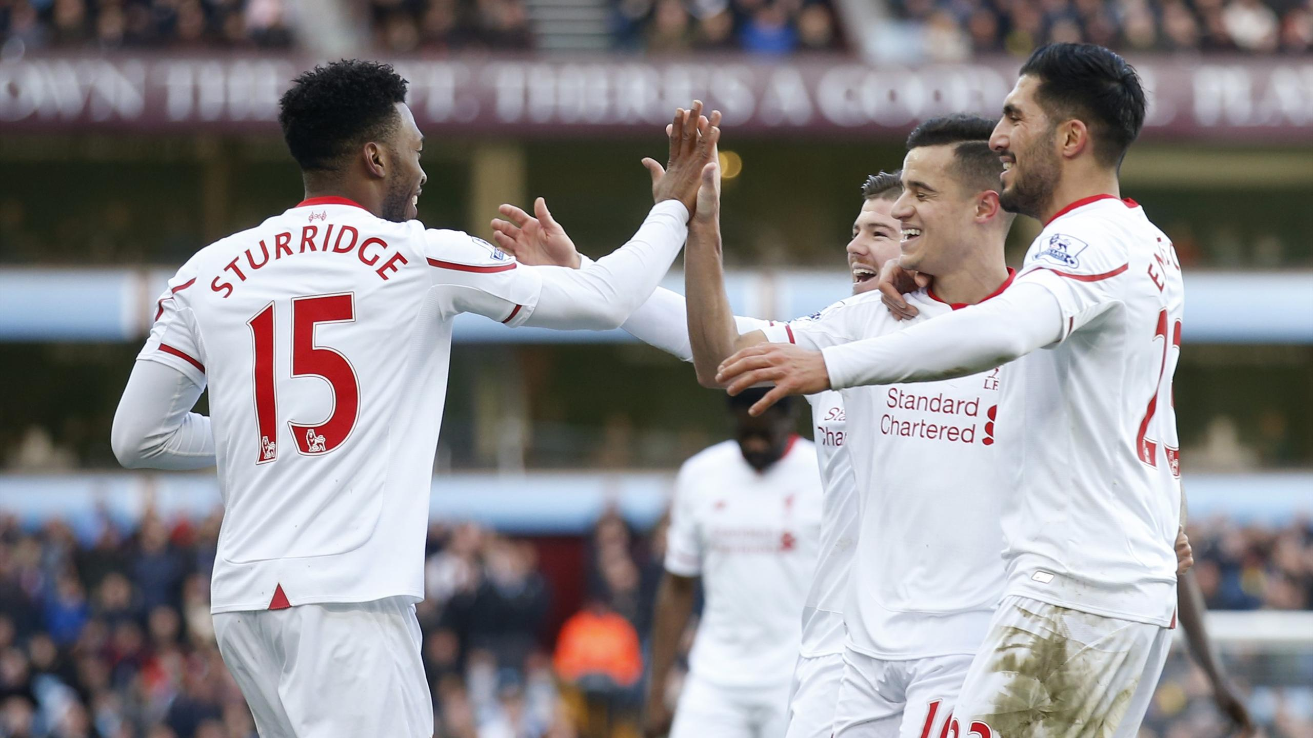 Daniel Sturridge celebrates scoring the first goal for Liverpool with team mates