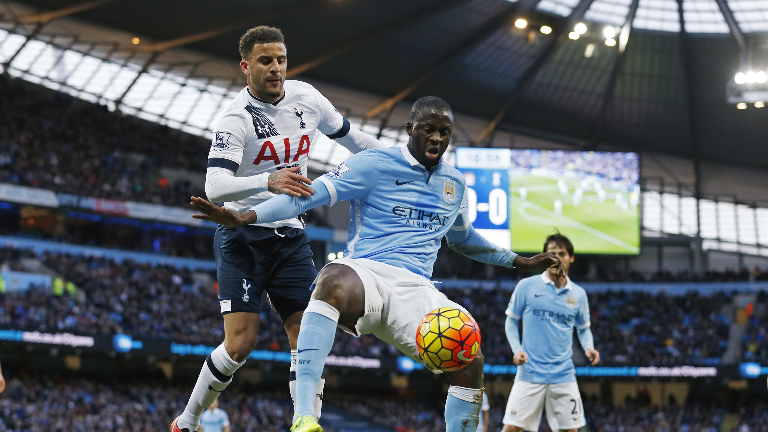 Manchester City's Yaya Toure in action with Tottenham's Kyle Walker