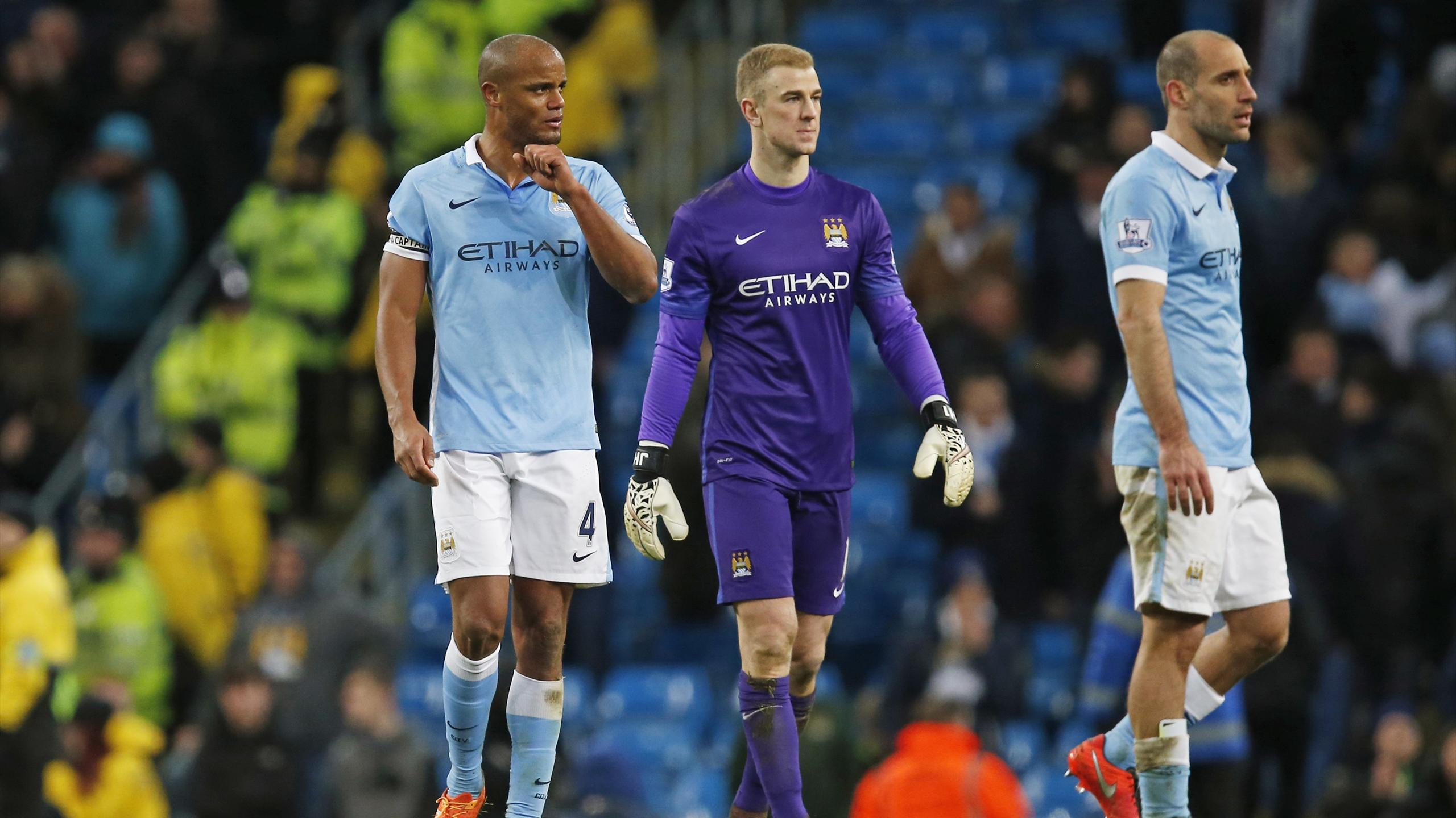 Manchester City's Vincent Kompany, Joe Hart and Pablo Zabaleta look dejected at the end of the match