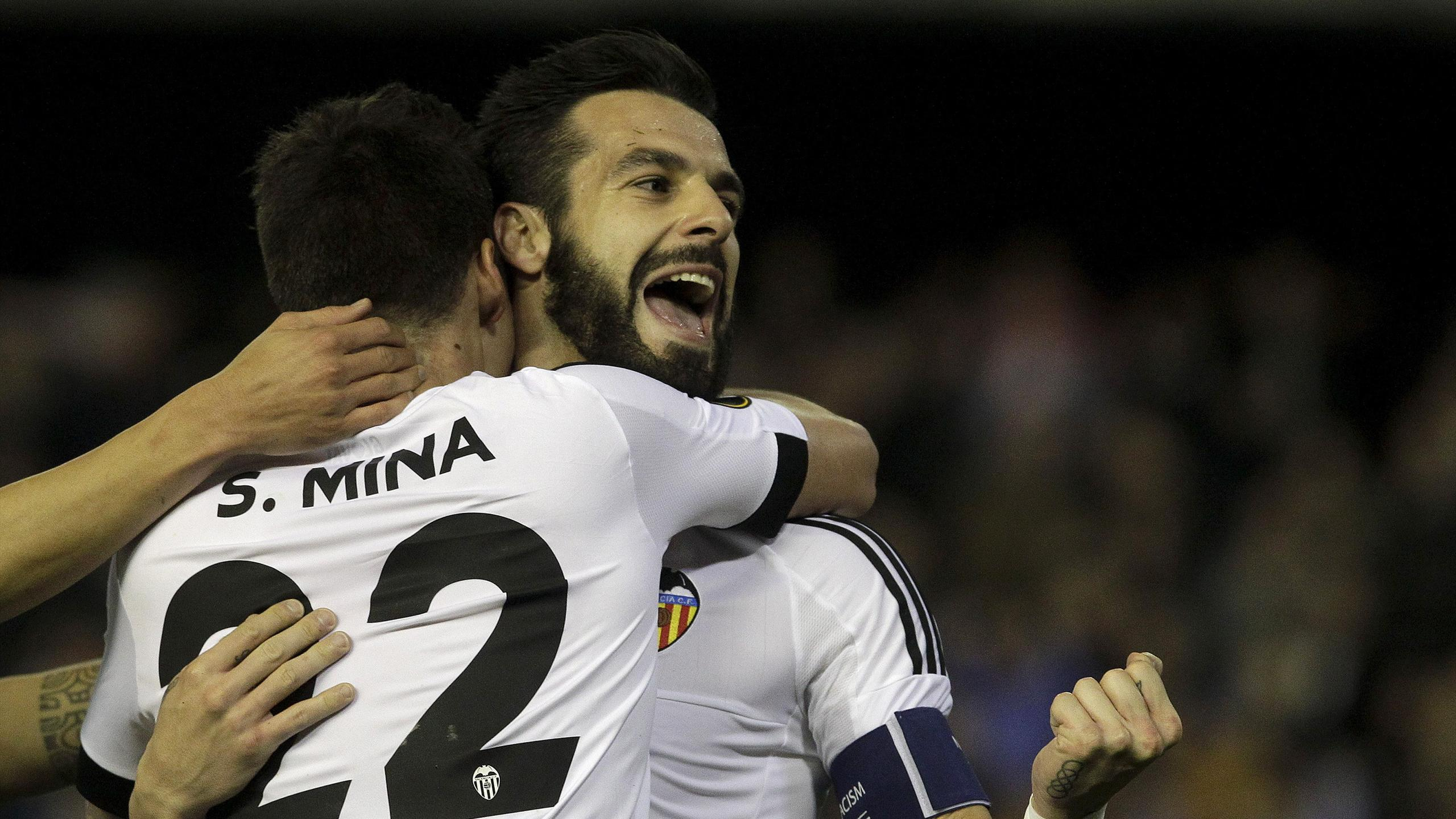 Valencia's Alvaro Negredo celebrates with teammate Santi Mina
