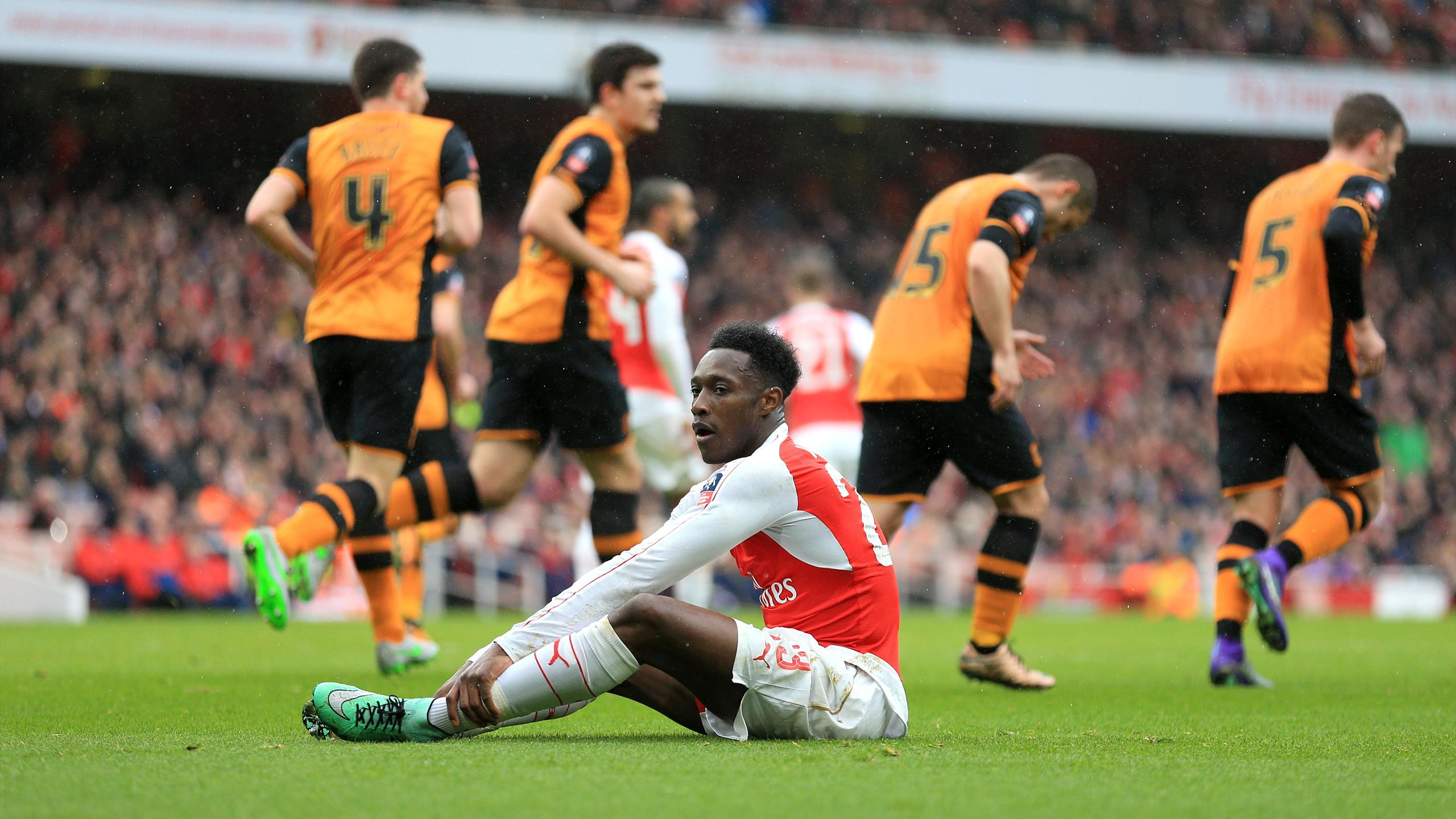 Arsenal's Danny Welbeck sits dejected after missing a chance.