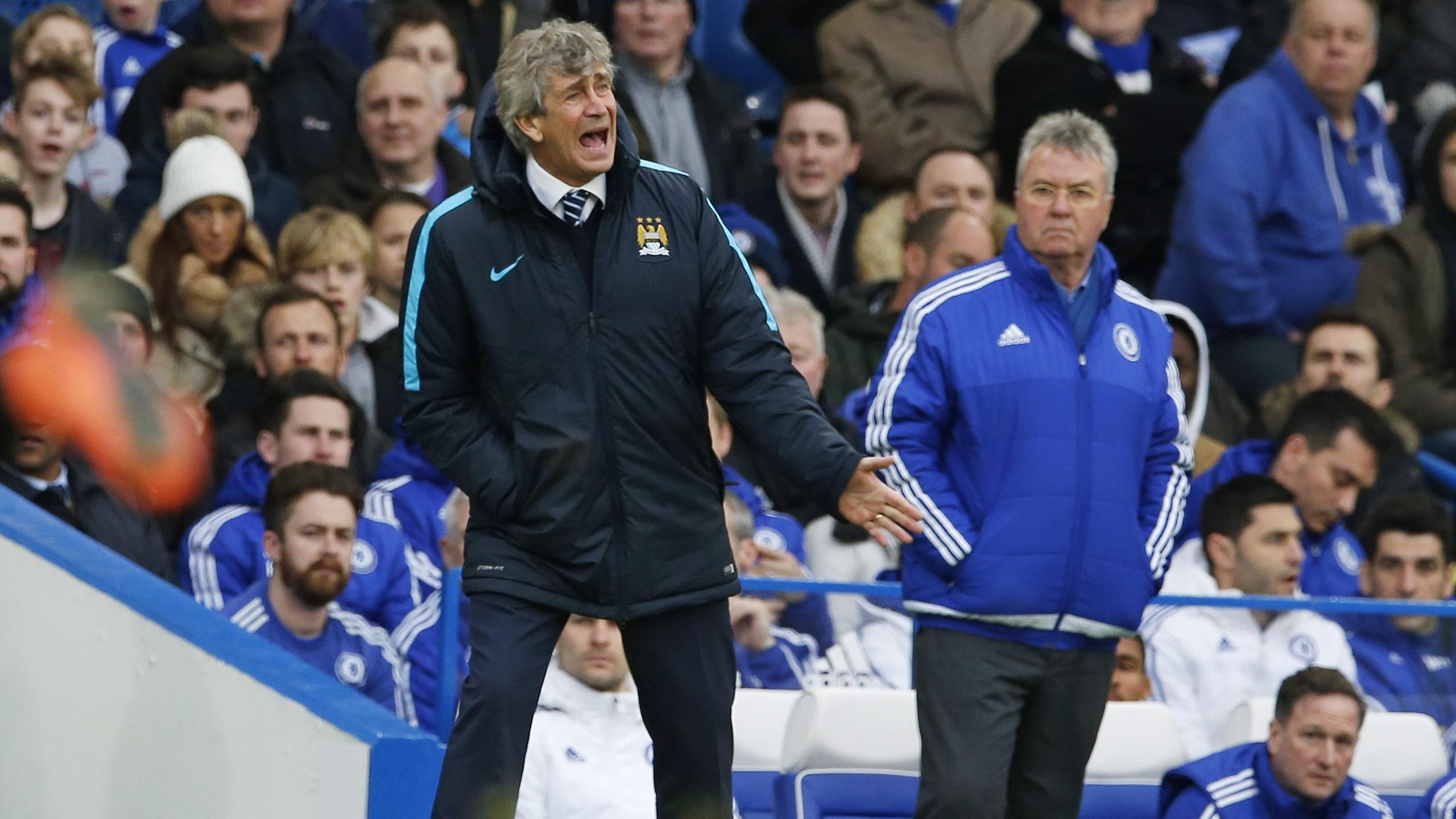 Manchester City manager Manuel Pellegrini and Chelsea manager Guus Hiddink