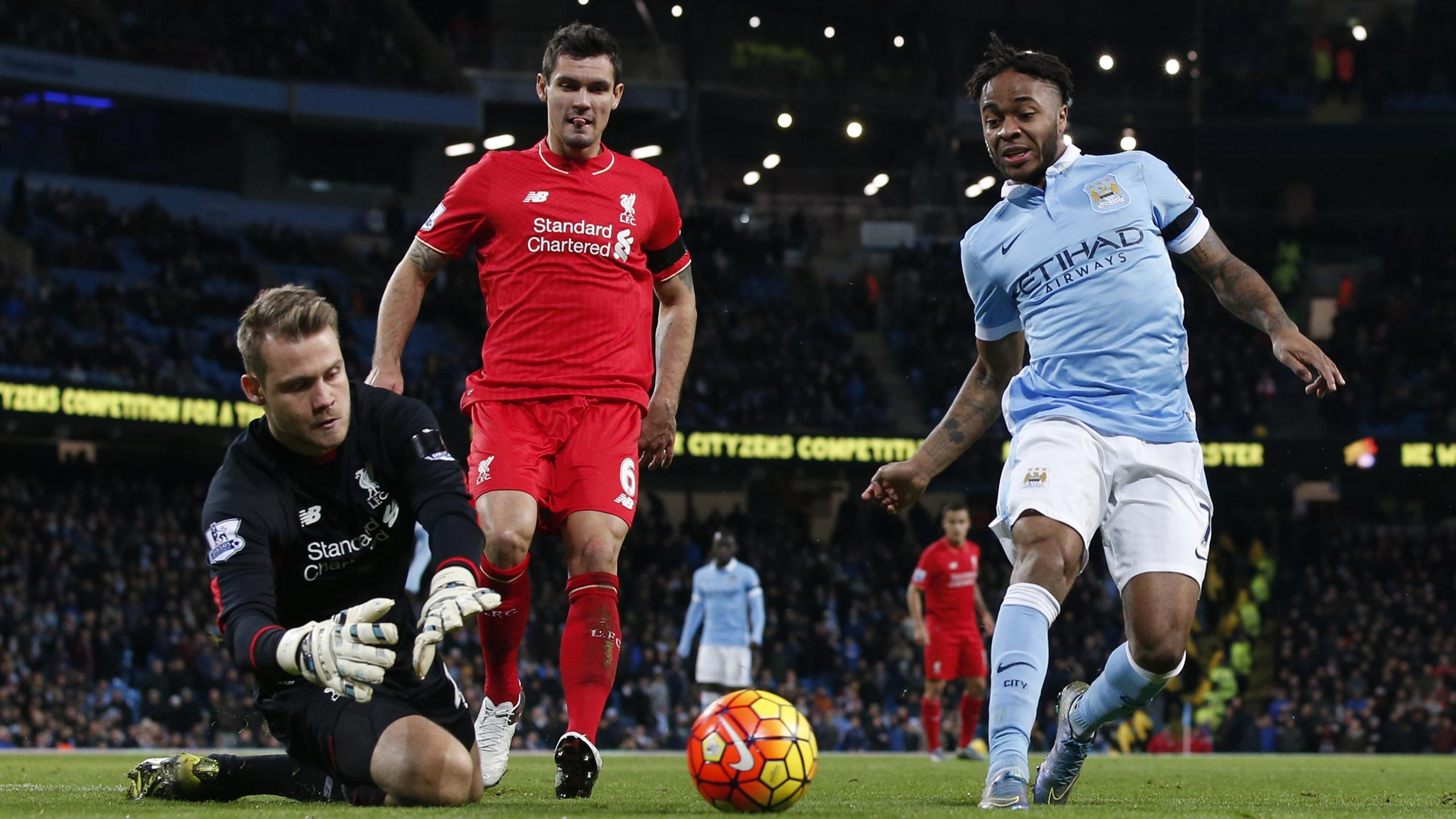 Liverpool's Simon Mignolet saves from Manchester City's Raheem Sterling