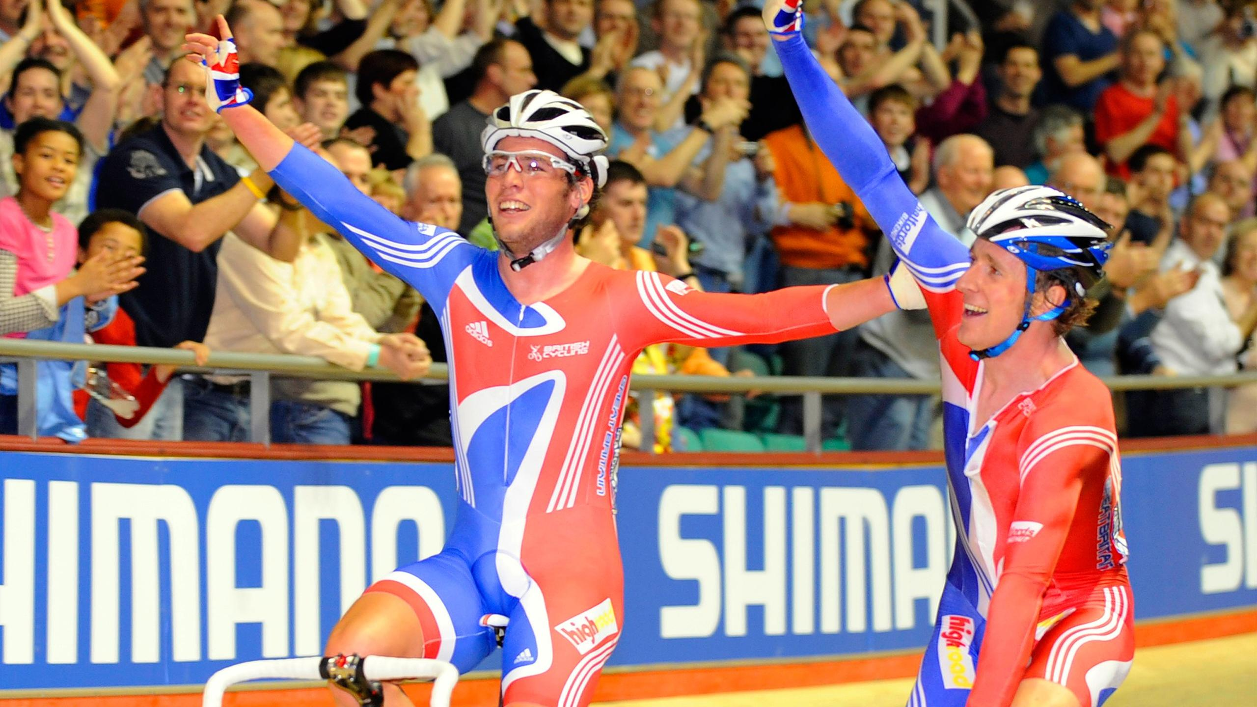 Britain's Bradley Wiggins (R) and Mark Cavendish react after winning gold in the men's Madison on the fourth day of competition at the track cycling world championships in Manchester in 2008