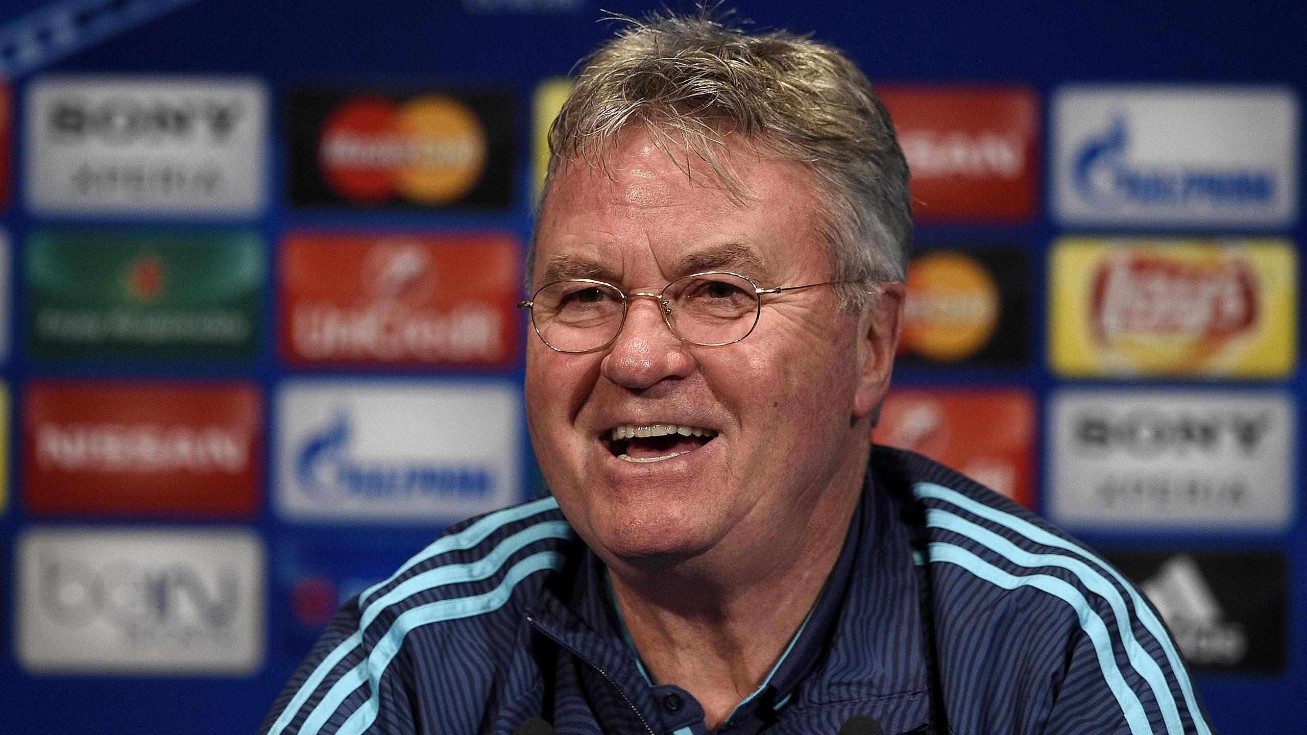 Chelsea's football club Dutch manager Guus Hiddink smiles during a press conference
