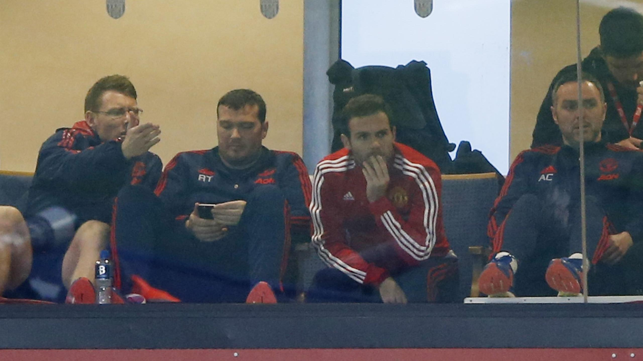 Manchester United midfielder Juan Mata watches from the stands