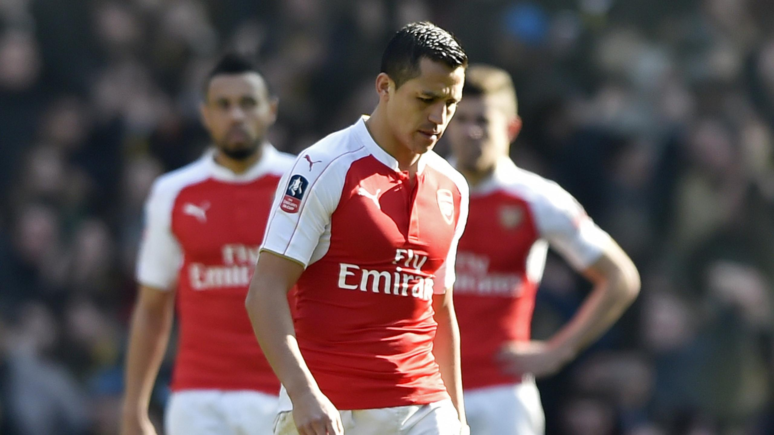 Arsenal's Alexis Sanchez looks dejected after Odion Ighalo (not pictured) scores the first goal for Watford