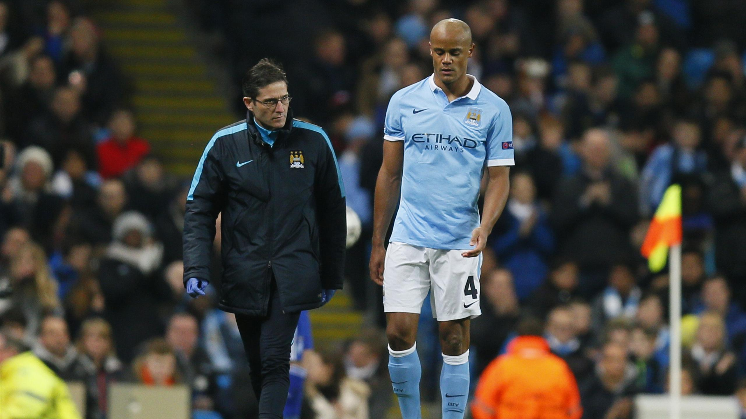Manchester City's Vincent Kompany looks dejected as he walks off to be substituted after sustaining an injury