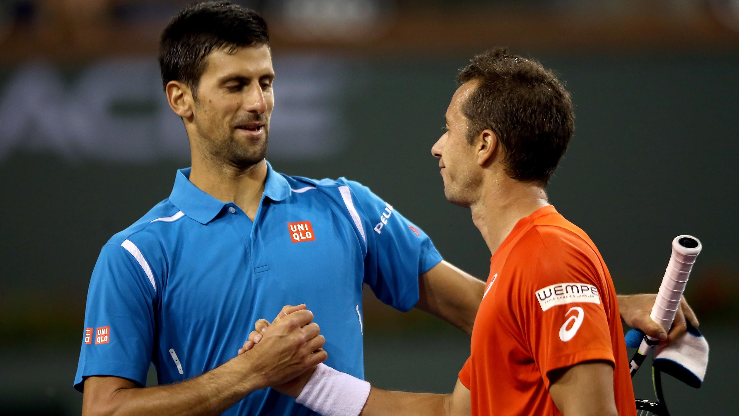 Novak Djokovic of Serbia is congratulated by Philipp Kohlschreiber of Germany after their match at Indian Wells