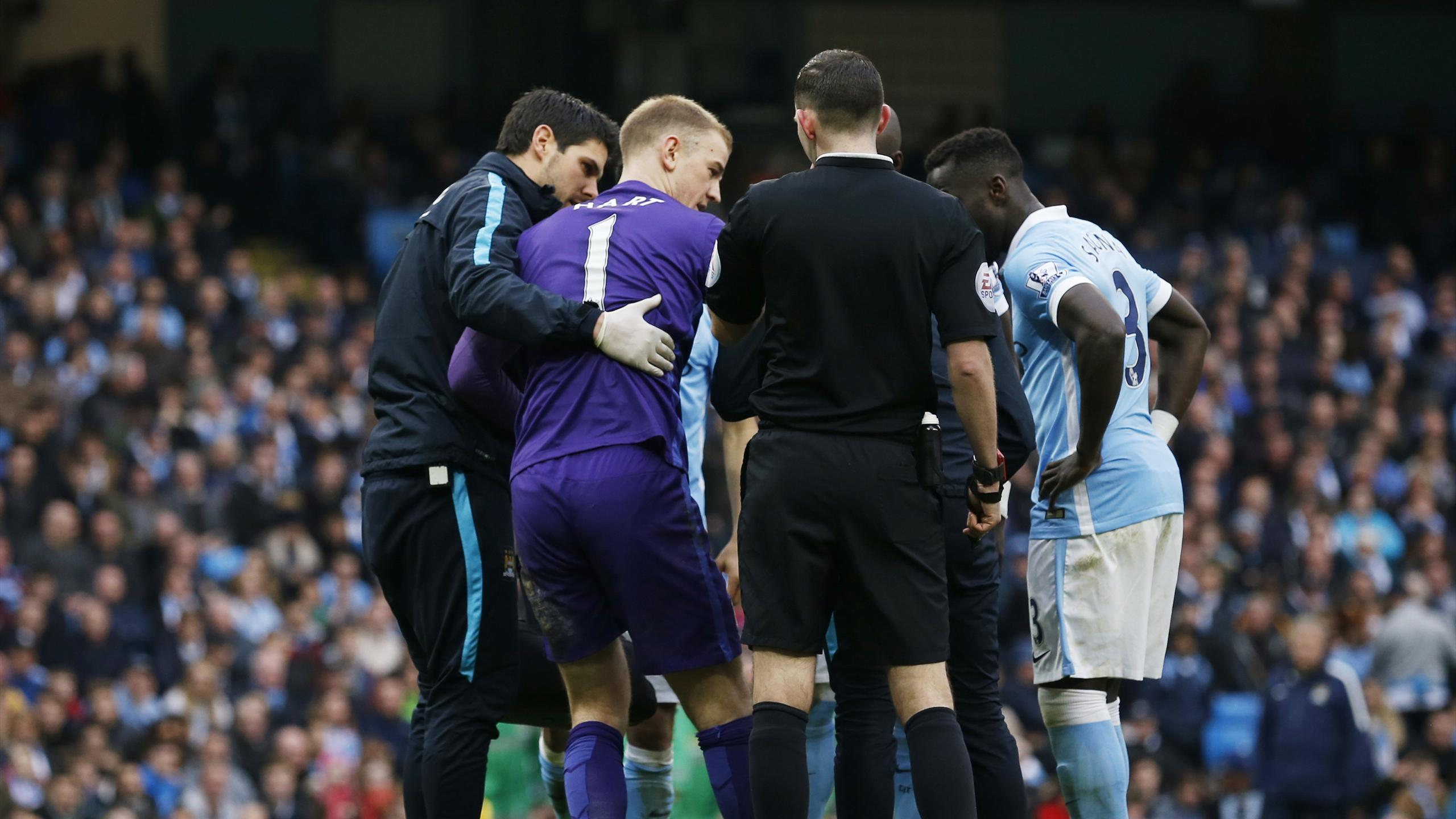 Manchester City's Joe Hart receives treatment after sustaining an injury