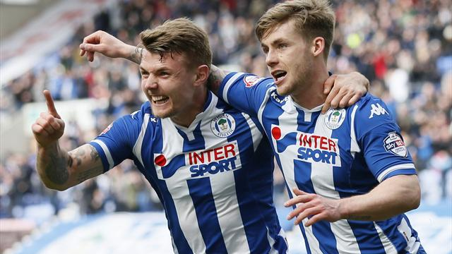 Wigan take top spot as Burton draw