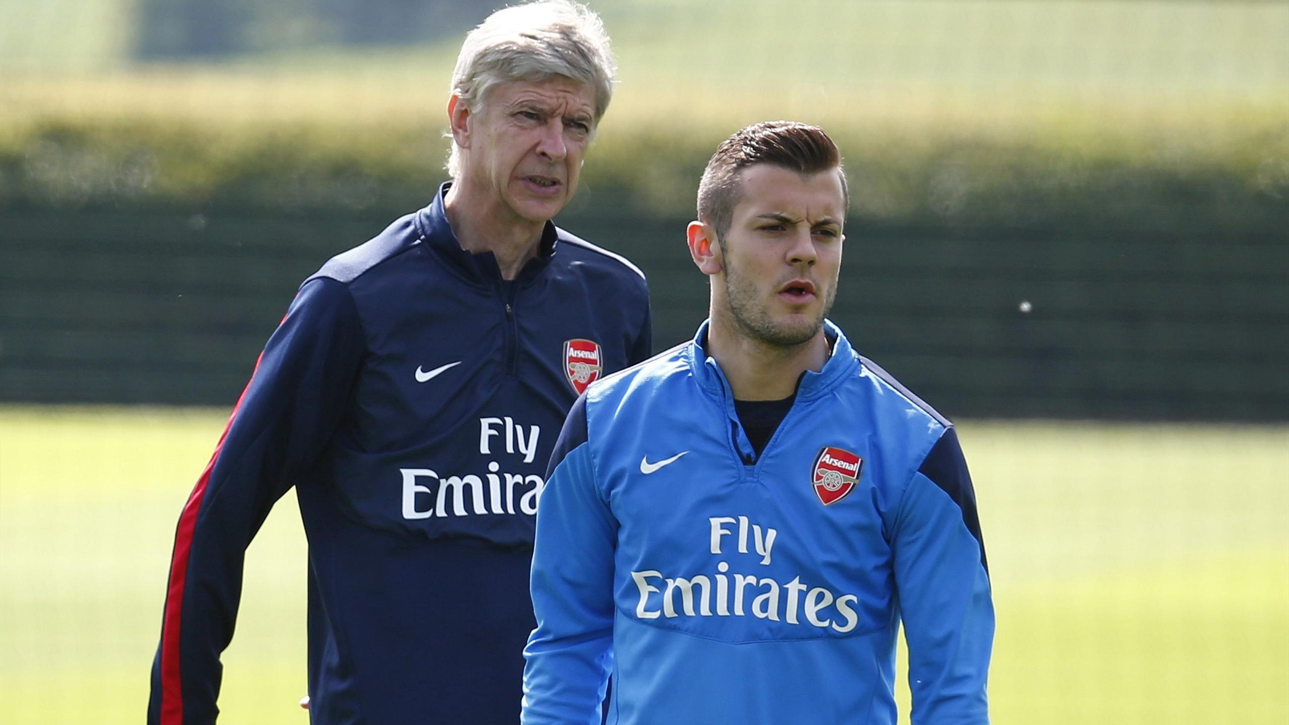 Arsenal manager Arsene Wenger and Jack Wilshere during a training session