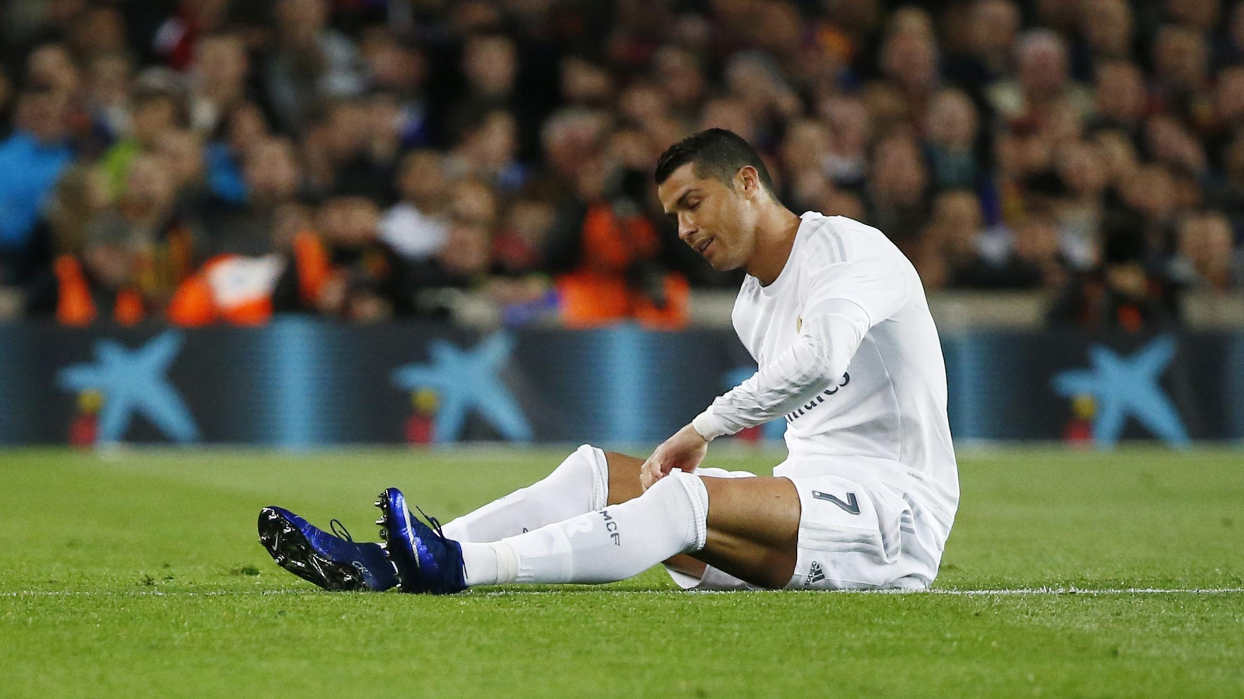 Real Madrid's Cristiano Ronaldo sits on the pitch