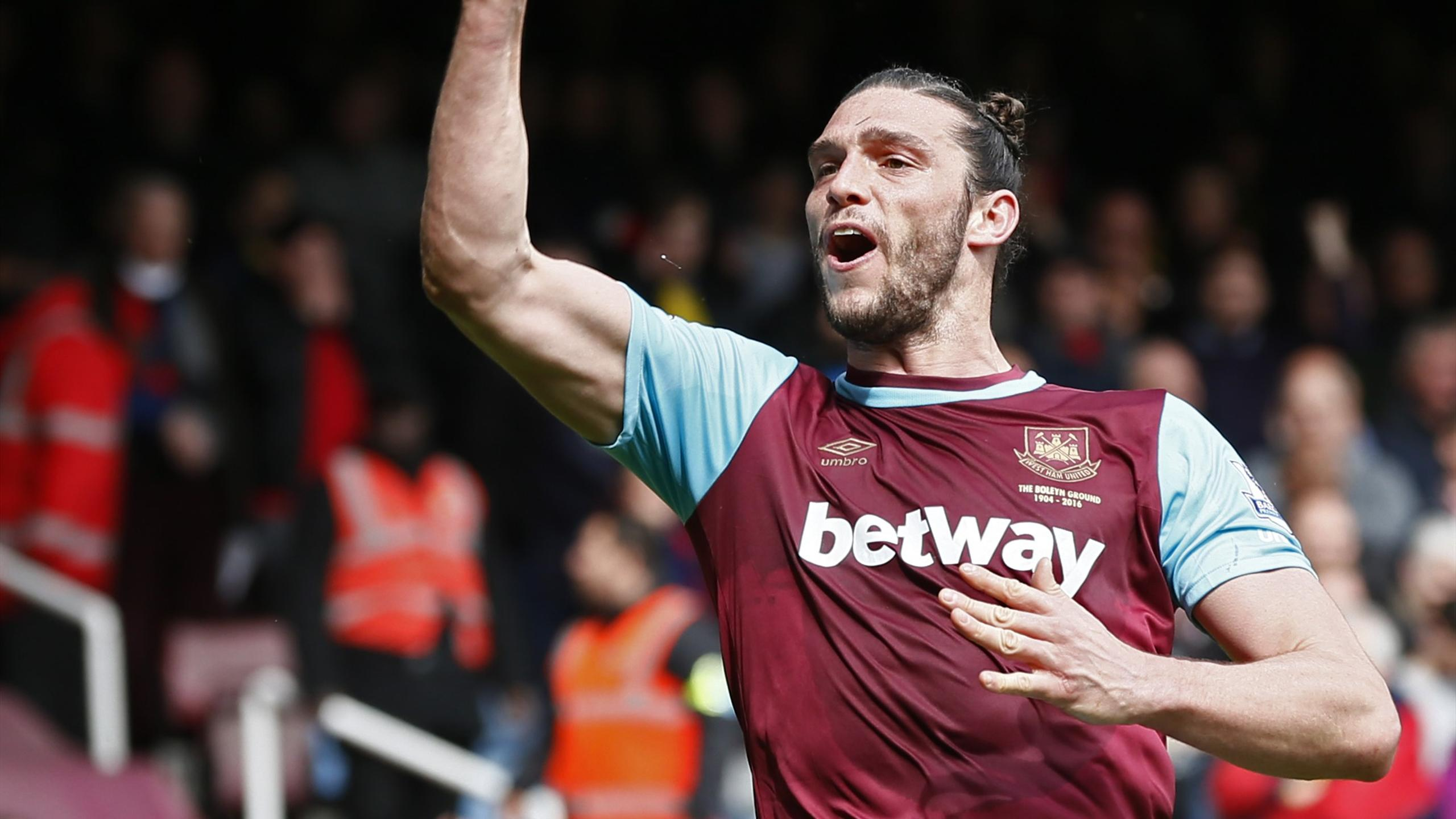 Andy Carroll celebrates scoring the second goal for West Ham against Arsenal
