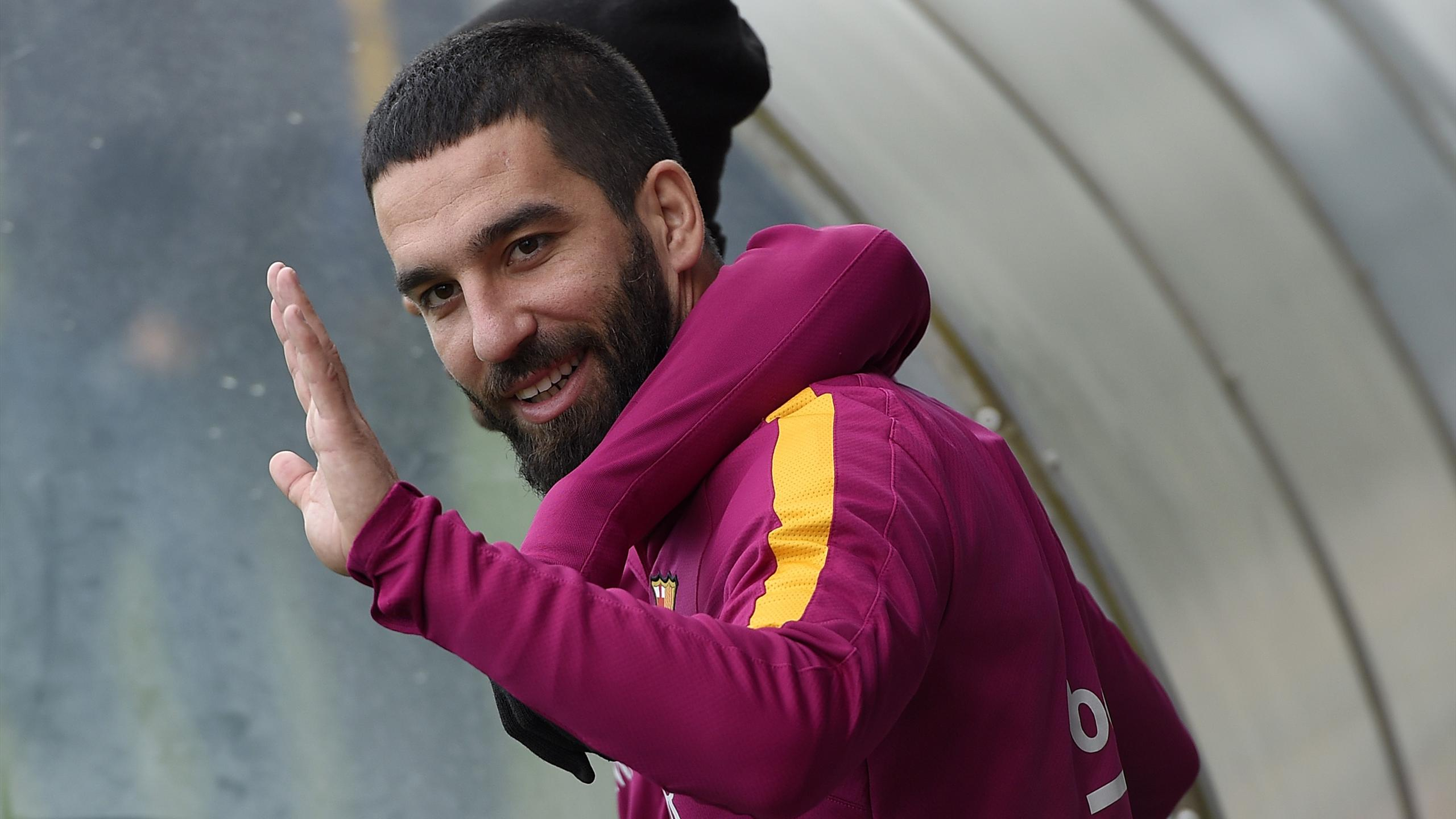 Barcelona's Turkish forward Arda Turan arrives for a training session at the Sports Center FC Barcelona Joan Gamper