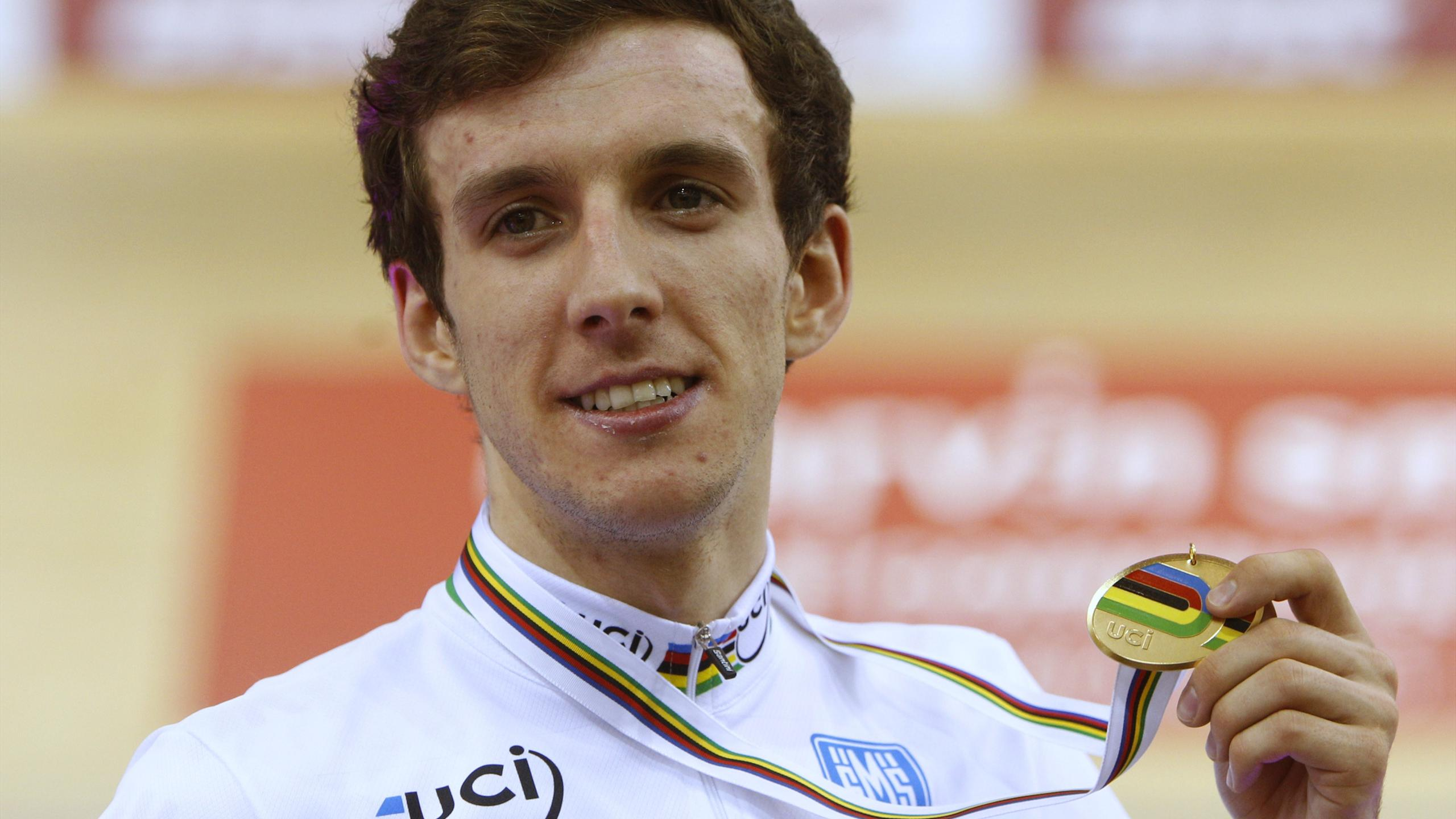 Britain's Simon Yates celebrates his gold medal during the men's points race at the UCI Track Cycling World Championships in Minsk