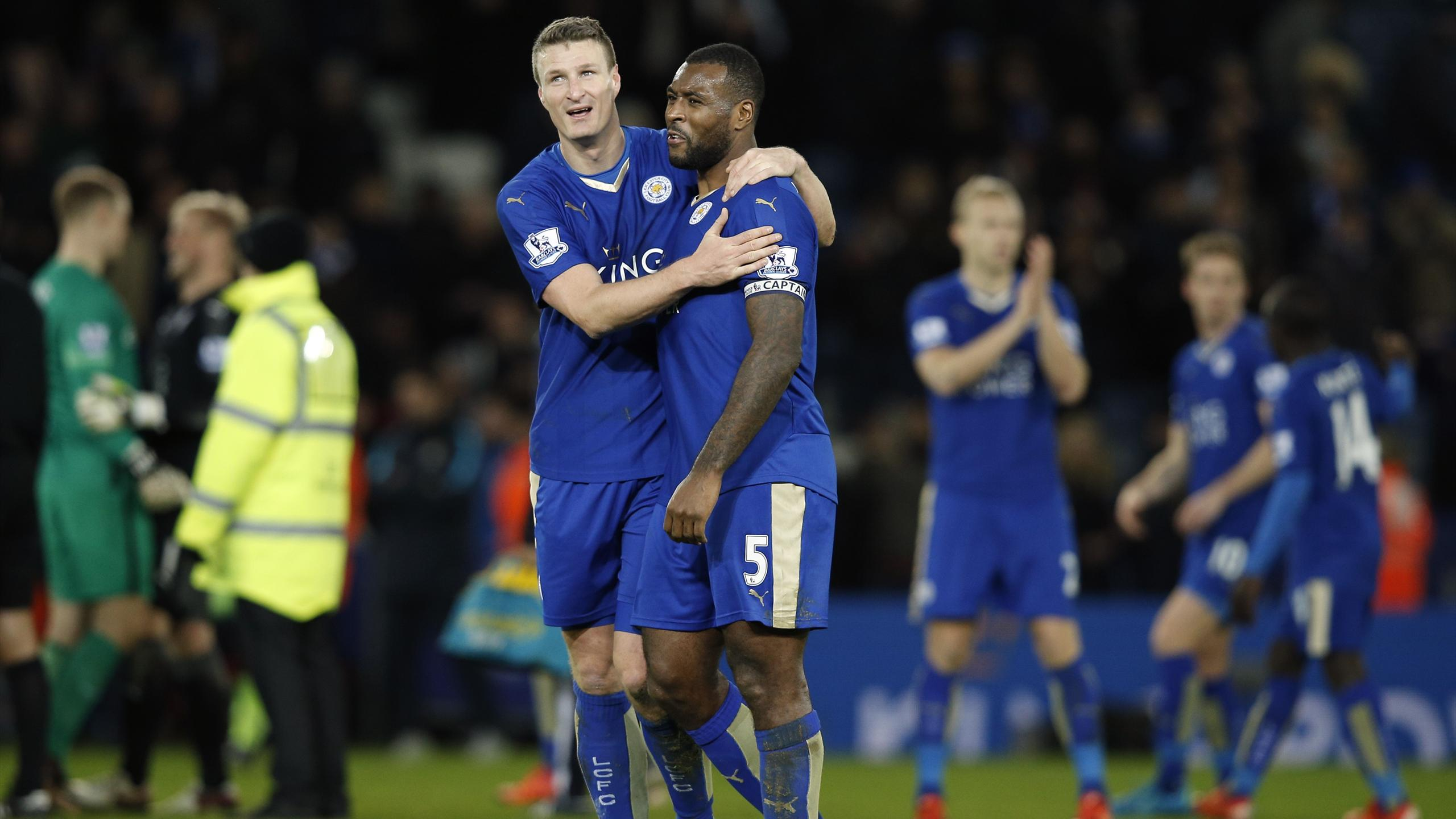 Leicester City's German defender Robert Huth and Leicester City's English defender Wes Morgan