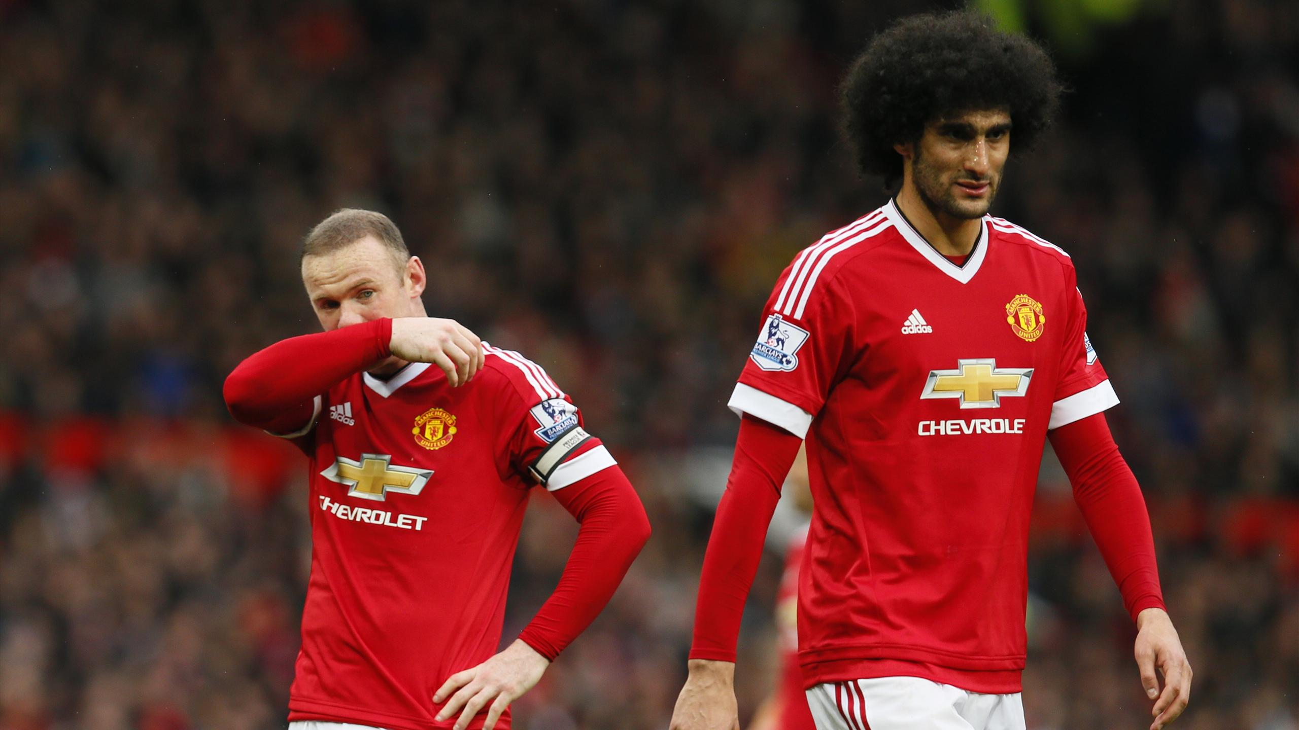 Marouane Fellaini in action against Leicester, with Wayne Rooney
