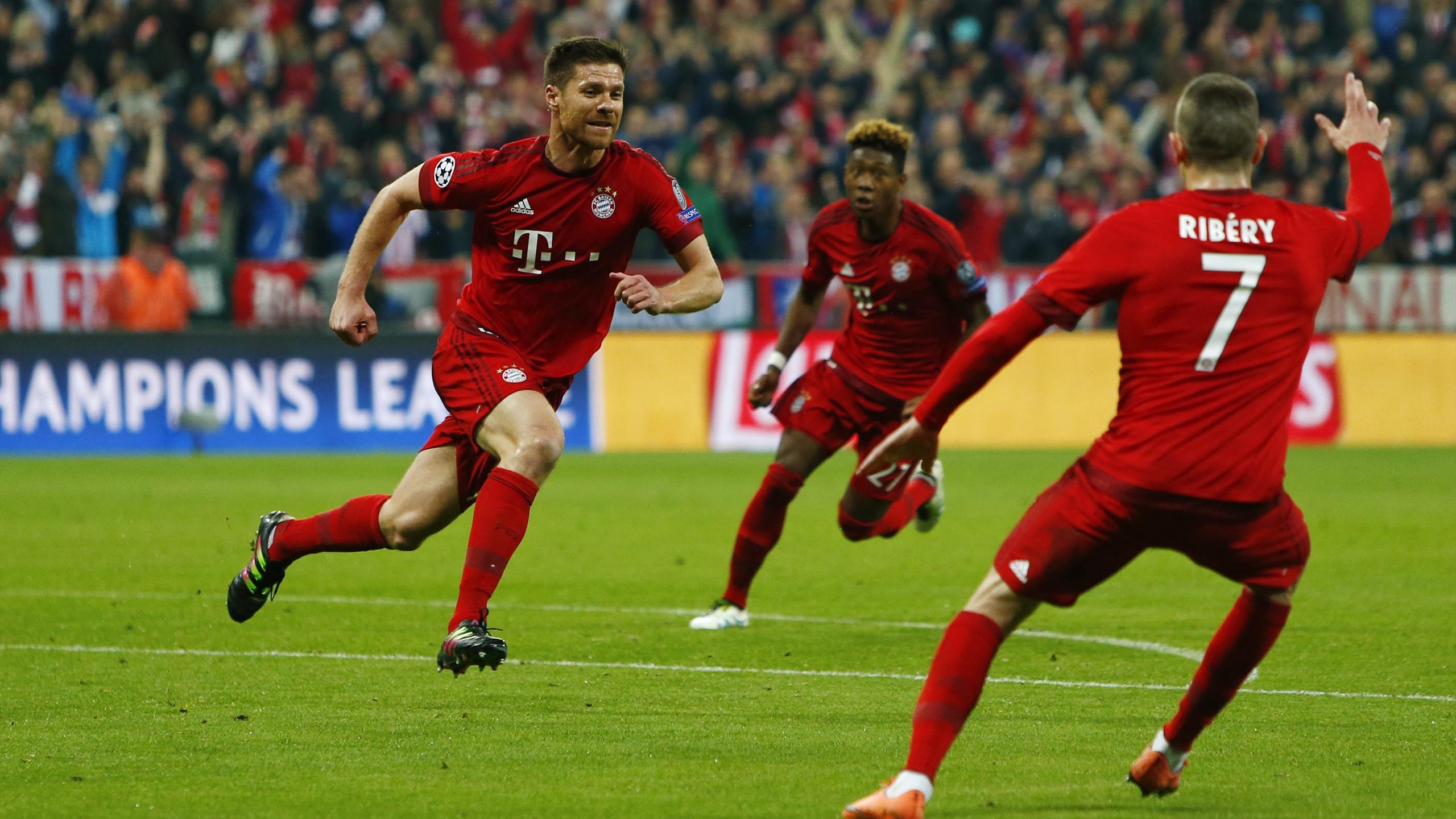 Xabi Alonso celebrates scoring the first goal for Bayern Munich