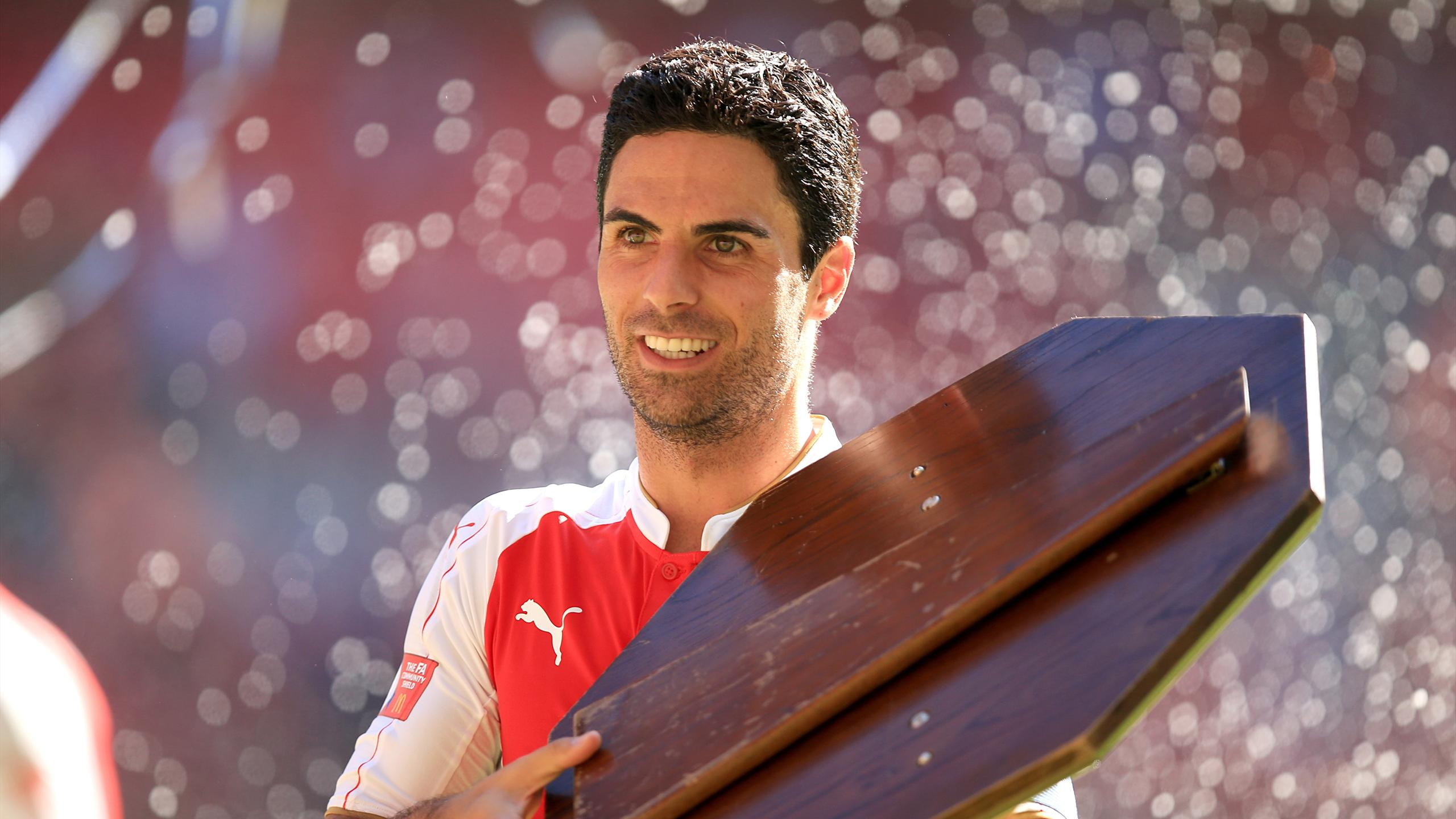 Arsenal's Mikel Arteta celebrates with the Community Shield after the game