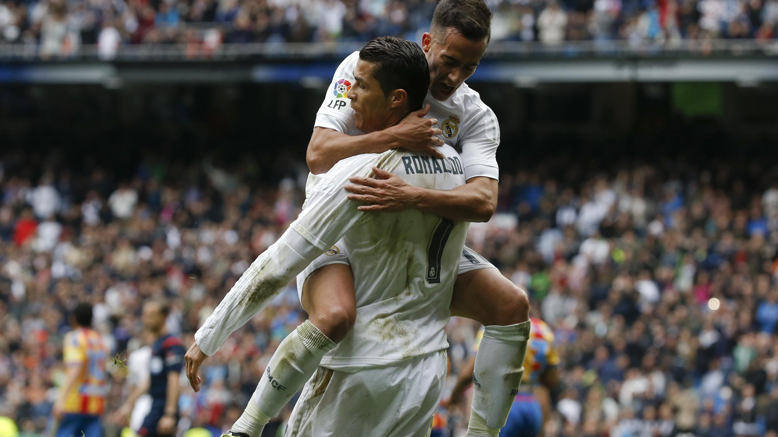 Real Madrid's Cristiano Ronaldo celebrates with team mate Lucas Vazquez after scoring a goal.