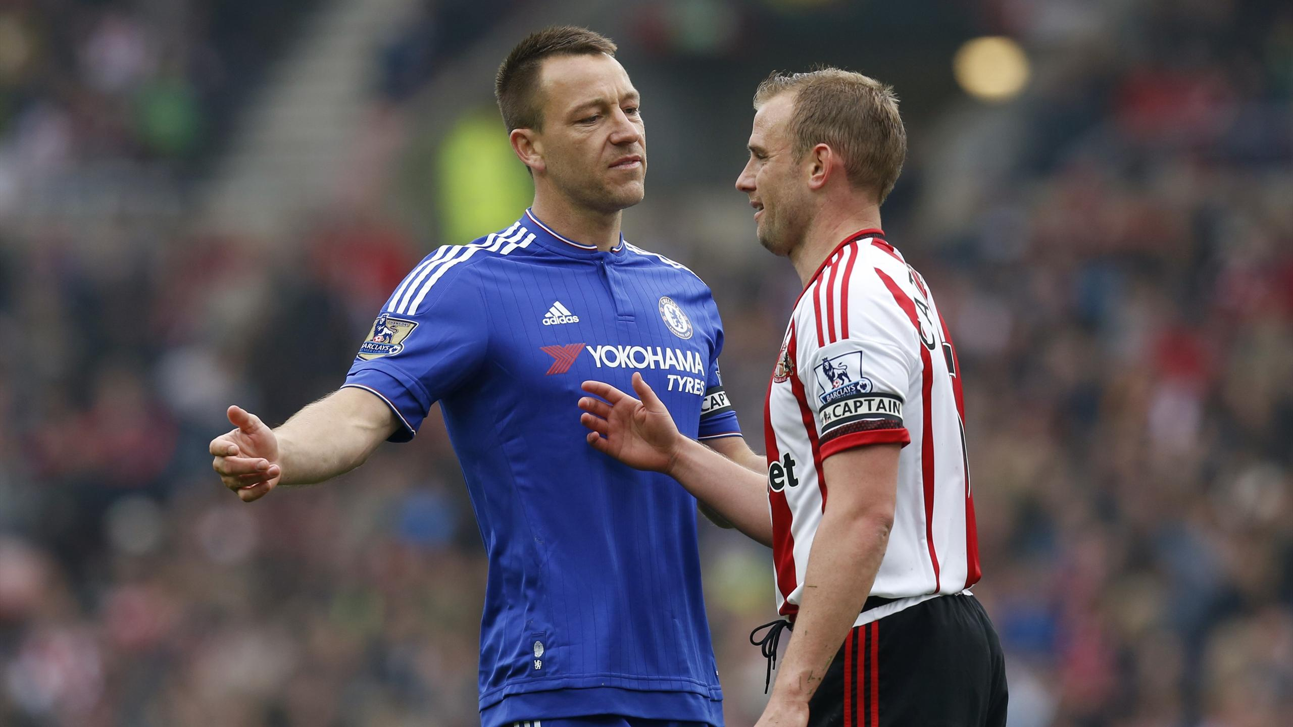 Sunderland's Lee Cattermole with Chelsea's John Terry