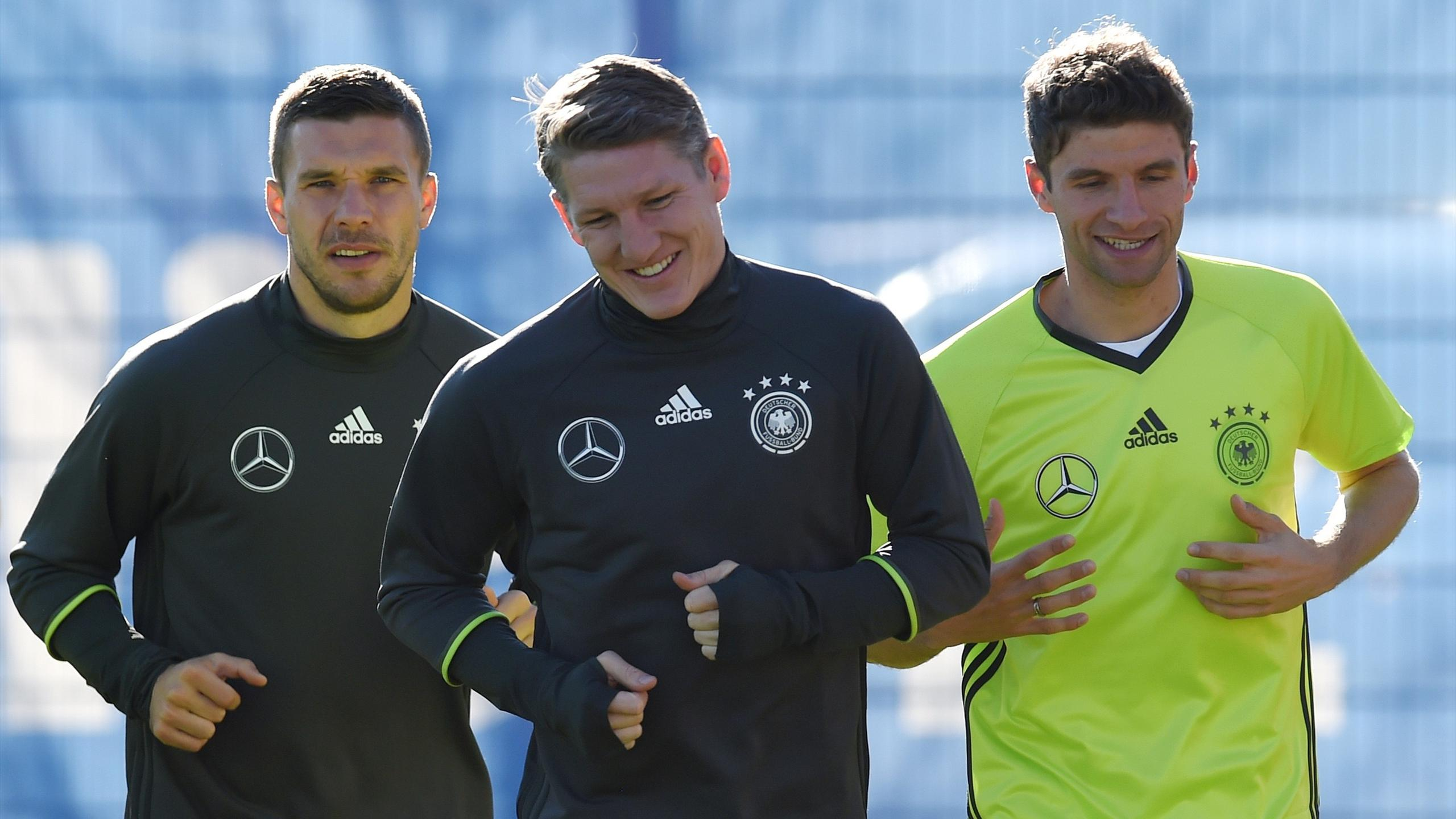 Germany's striker Lukas Podolski, midfielder Bastian Schweinsteiger and midfielder Thomas Mueller