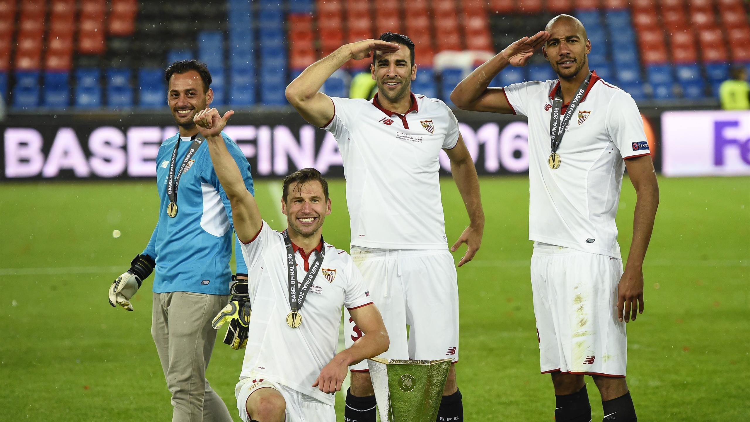 Sevilla's Beto, Grzegorz Krychowiak, Adil Rami and Steven N'Zonzi celebrate with the trophy after winning the UEFA Europa League Final