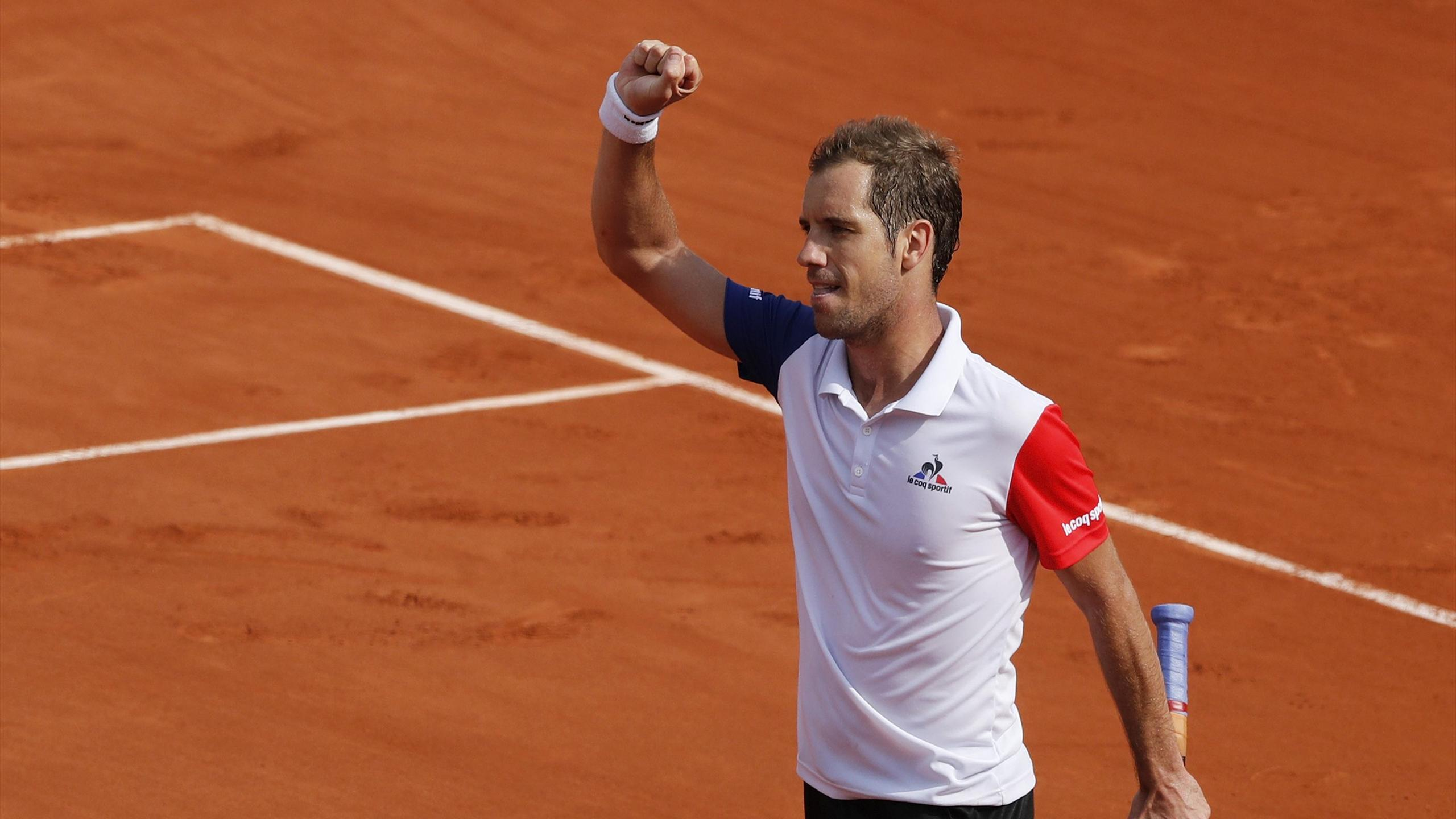 Richard Gasquet celebrates during the French Open at Roland Garros
