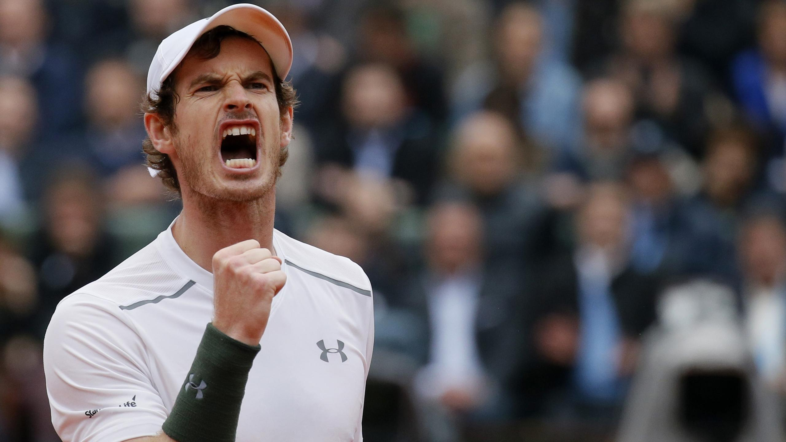 Andy Murray reacts during his match against Richard Gasquet at Roland Garros