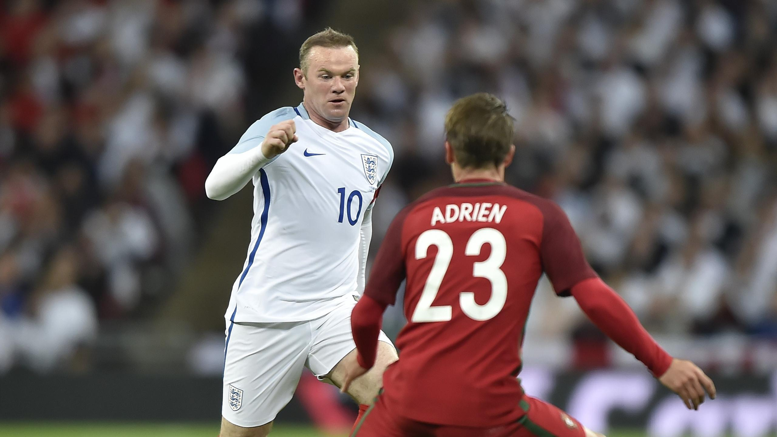 Wayne Rooney in possession for England against Portugal at Wembley