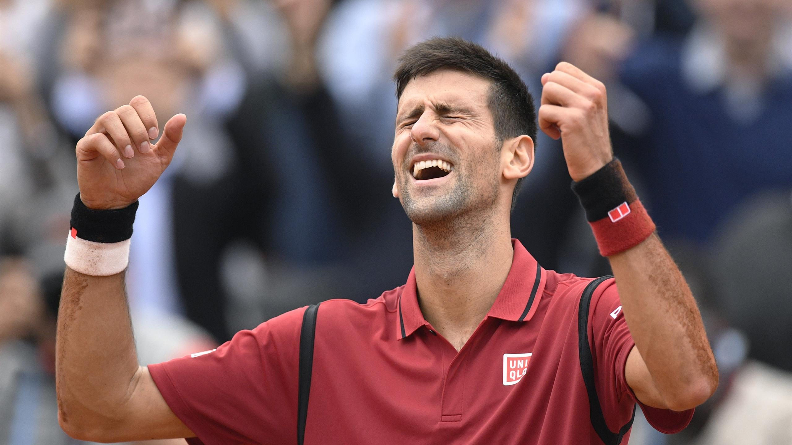 Serbia's Novak Djokovic reacts after winning the men's final match against Britain's Andy Murray at the Roland Garros 2016 French Tennis Open in Paris on June 5, 2016