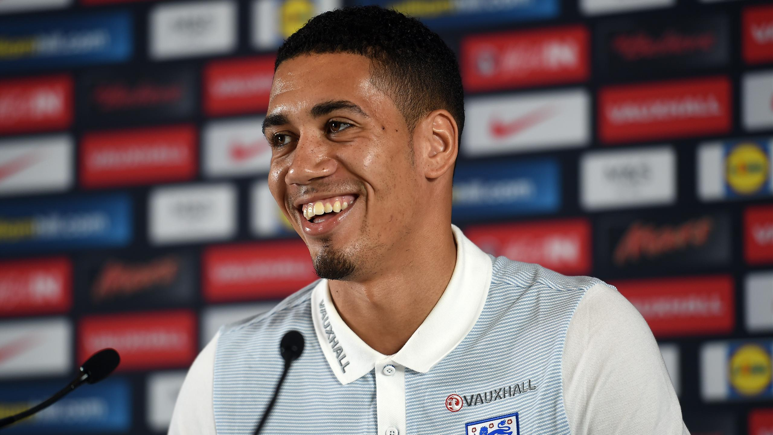 England's defender Chris Smalling attends a press conference in Chantilly, on June 8, 2016