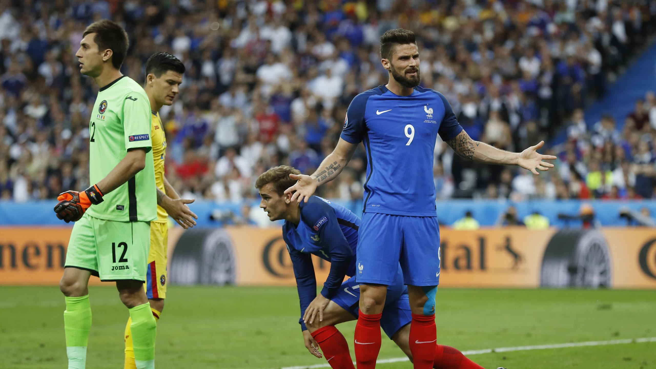 France's Olivier Giroud reacts after Antoine Griezmann missed a chance to score