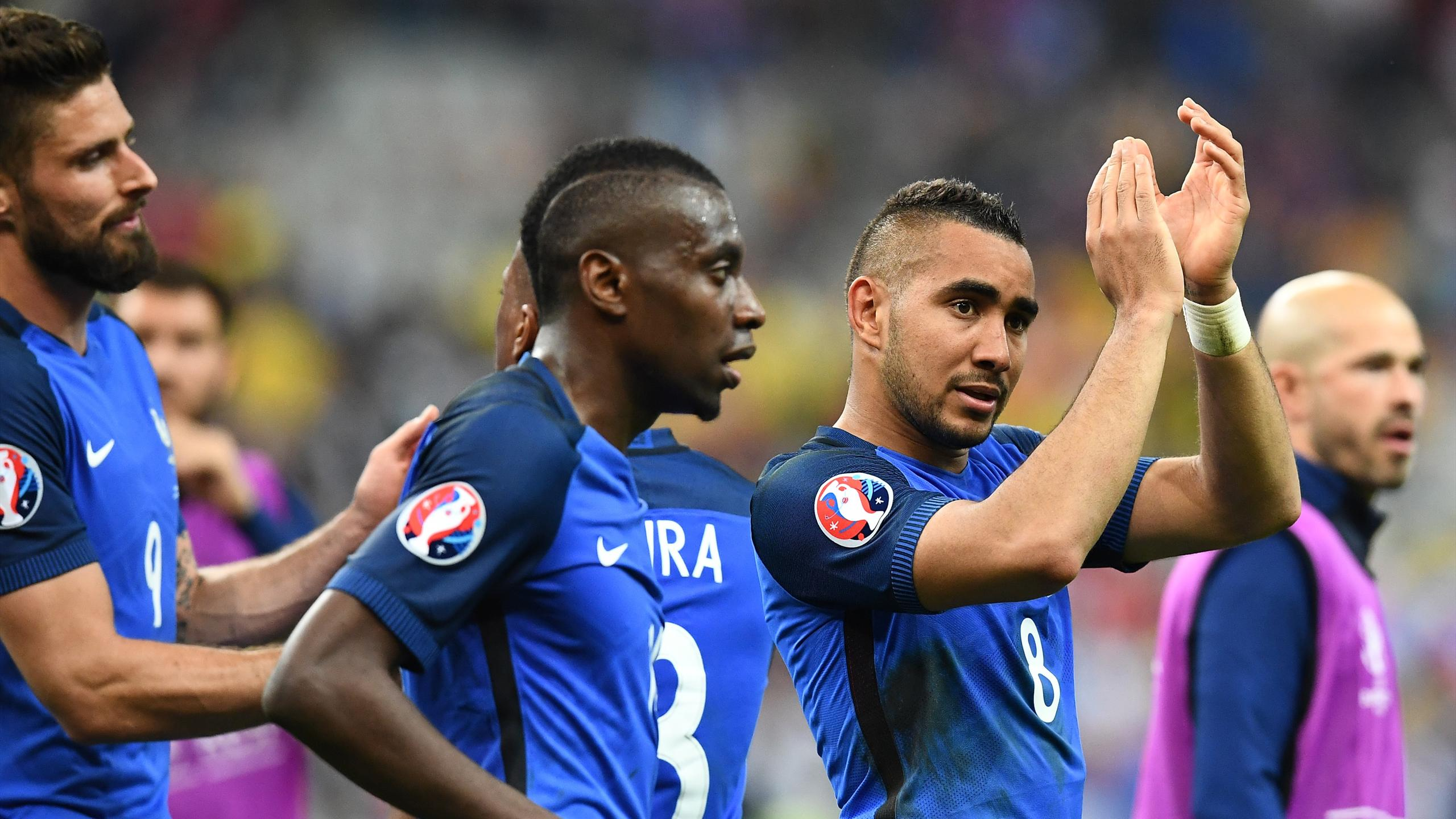 France's forward Dimitri Payet (R) and his teammates celebrate after the Euro 2016 group A football match between France and Romania