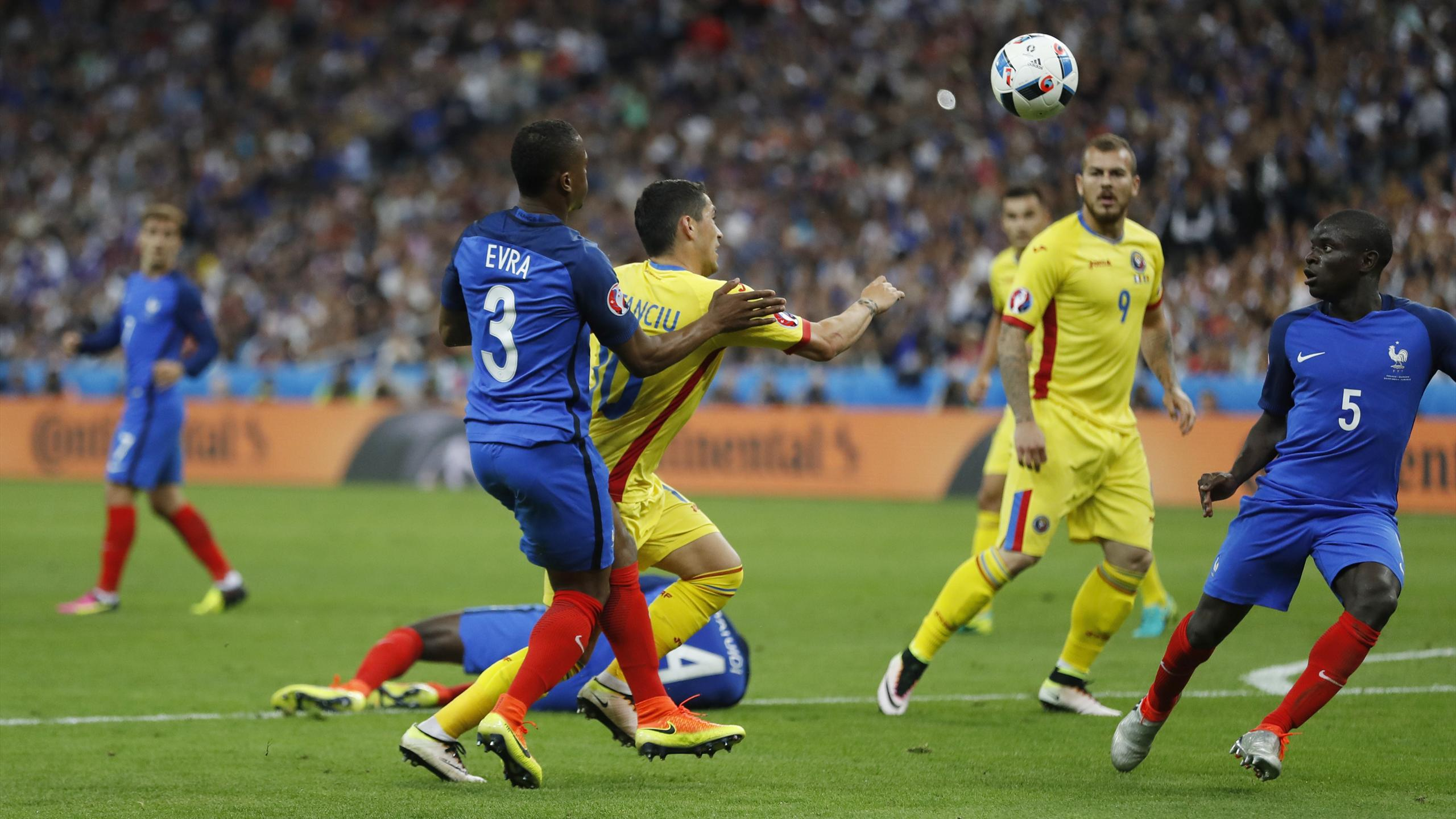 Romania's Nicolae Stanciu is fouled by France's Patrice Evra resulting in a penalty
