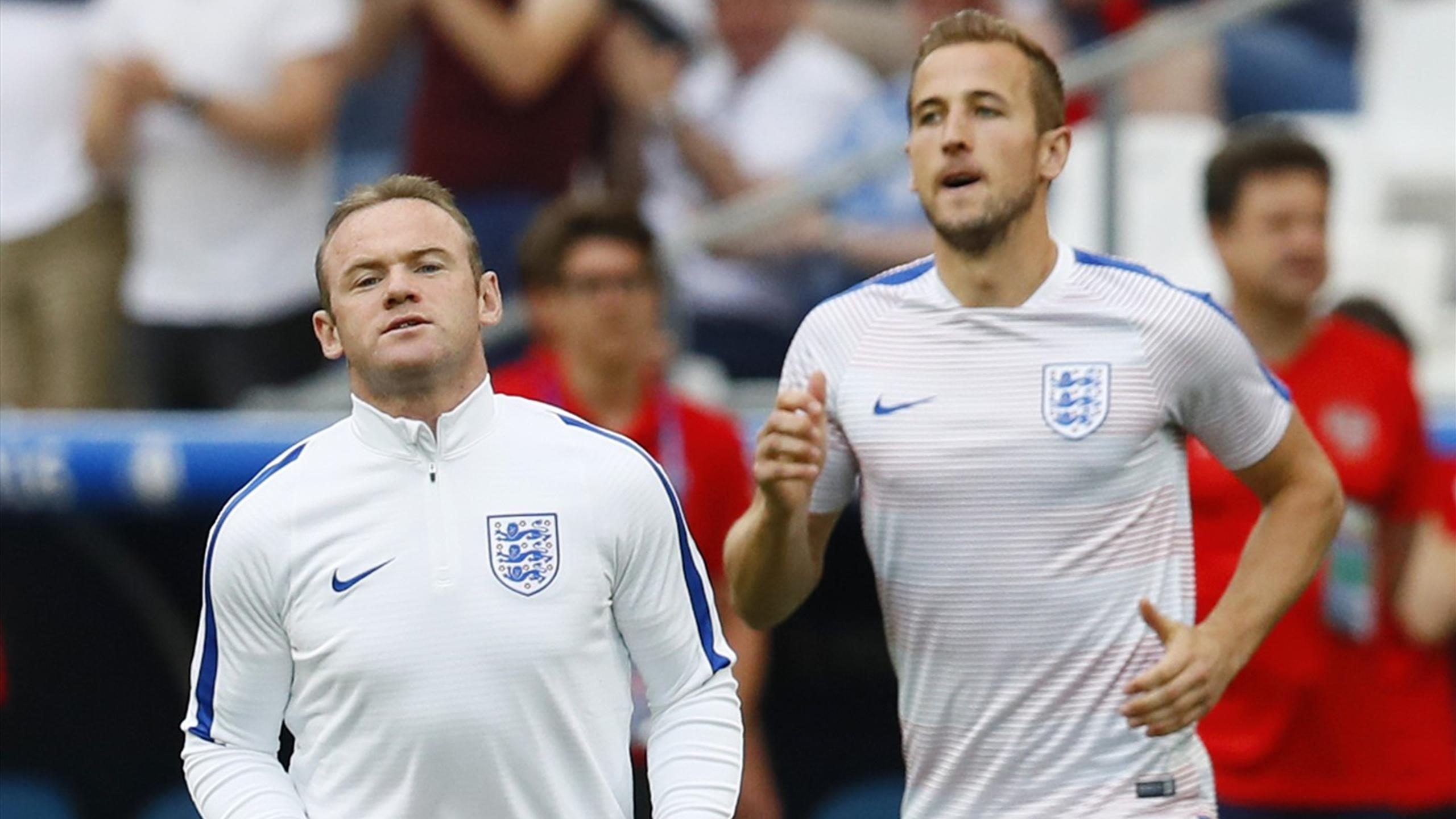 England's Wayne Rooney and Harry Kane warm up before the match against Russia