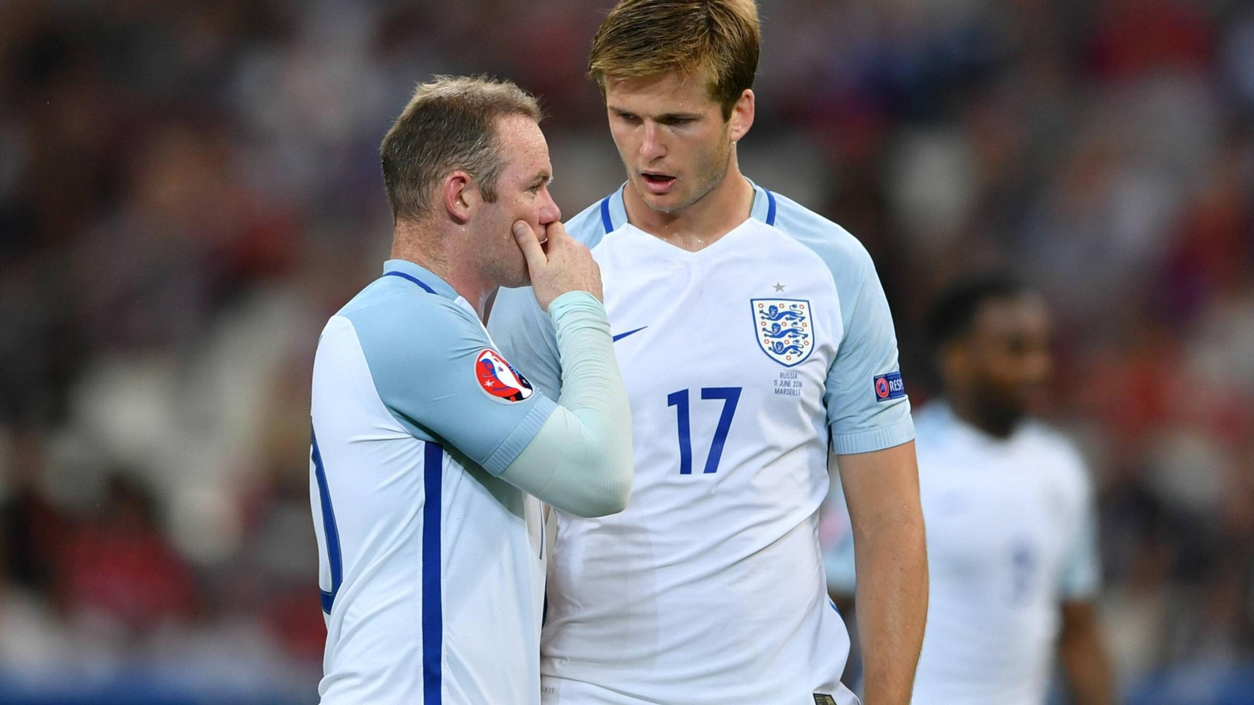 Englands skipper Wayne Rooney and his teammate eric dier in the match against russia