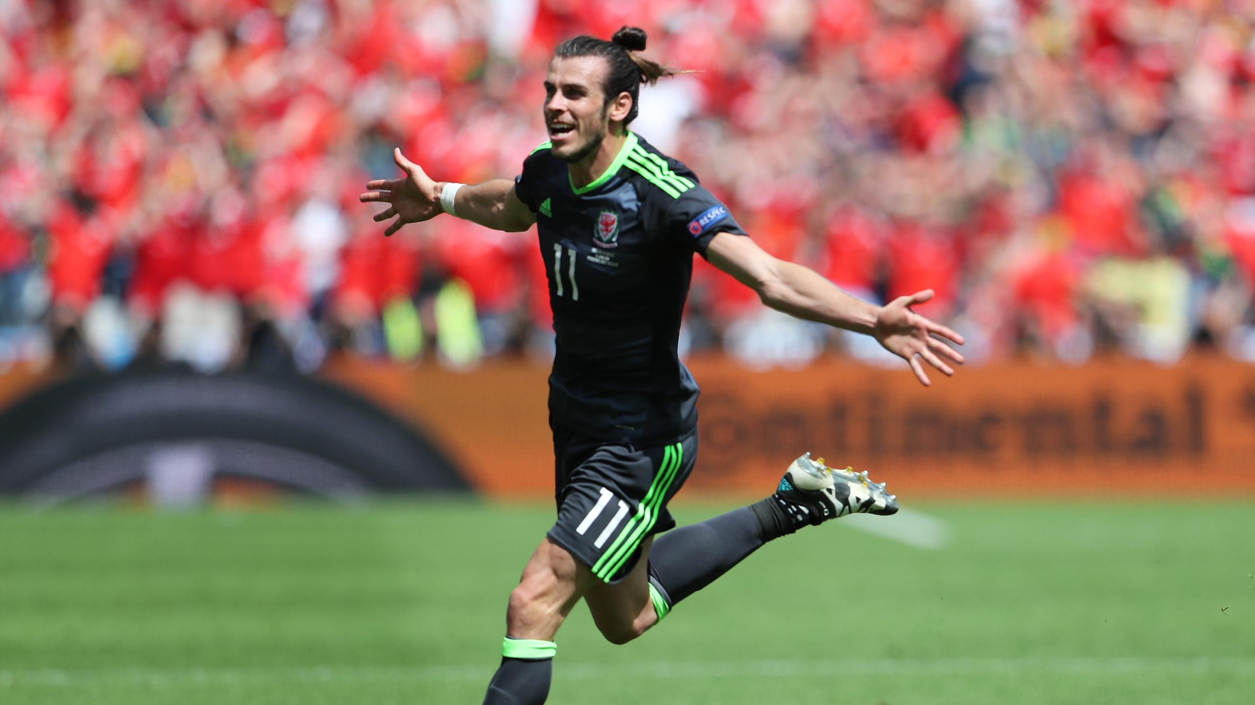 Wales' Gareth Bale celebrates after scoring their first goal