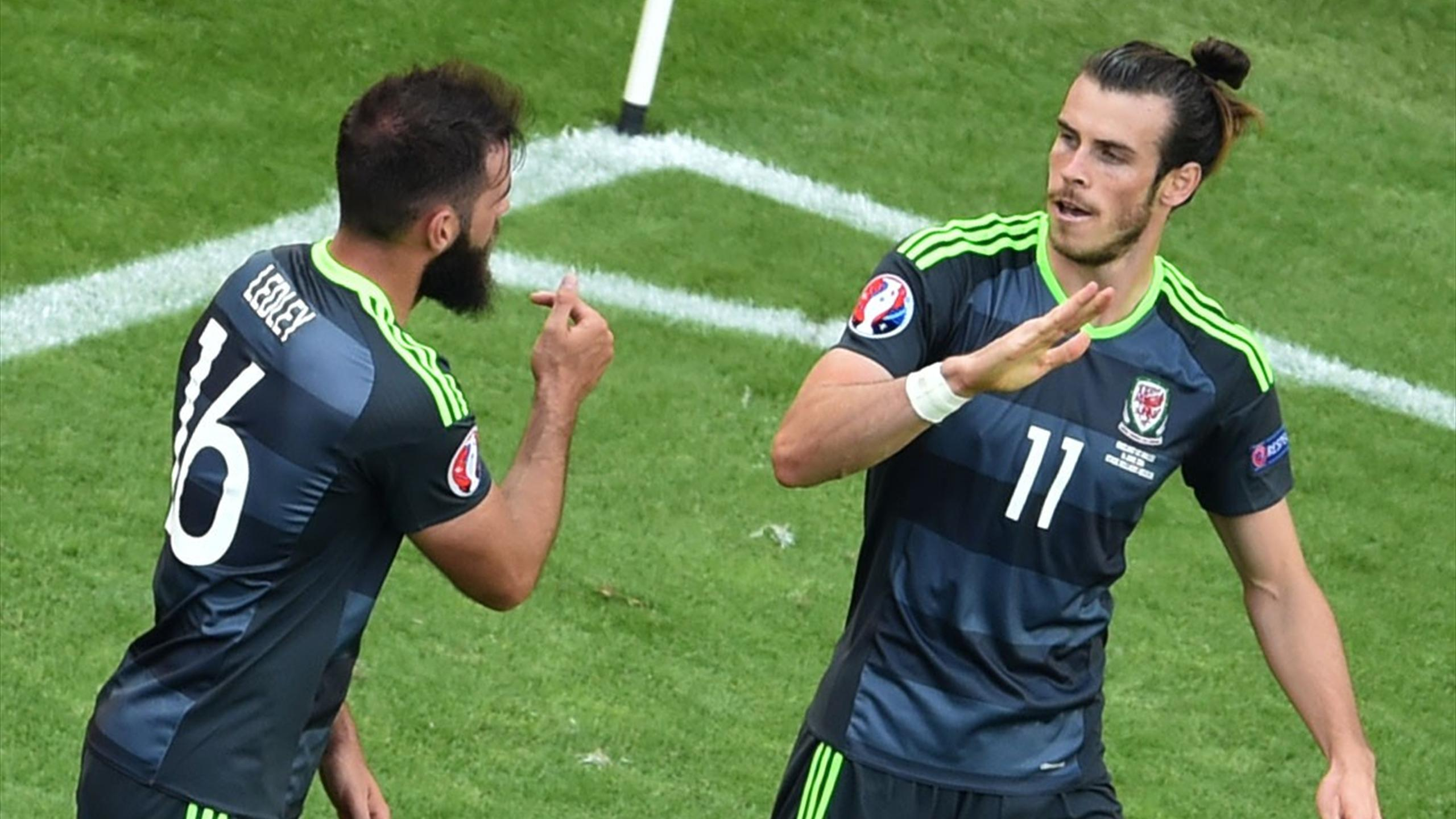 Wales' forward Gareth Bale (R) celebrates with Wales' midfielder Joe Ledley