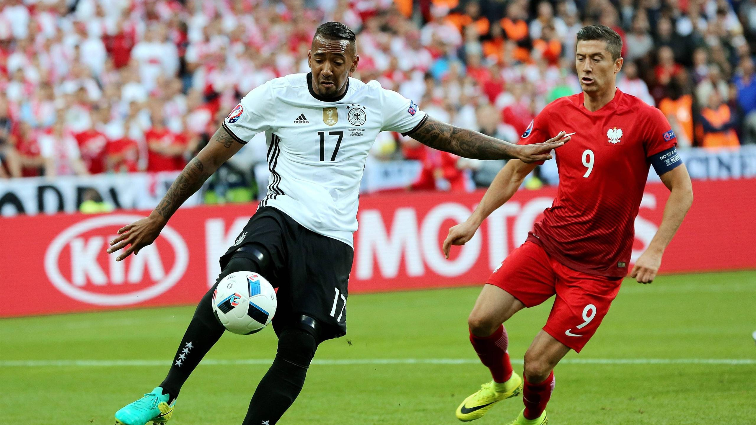 Germany defender Jerome Boateng in a duel with Robert Lewandowski from Poland