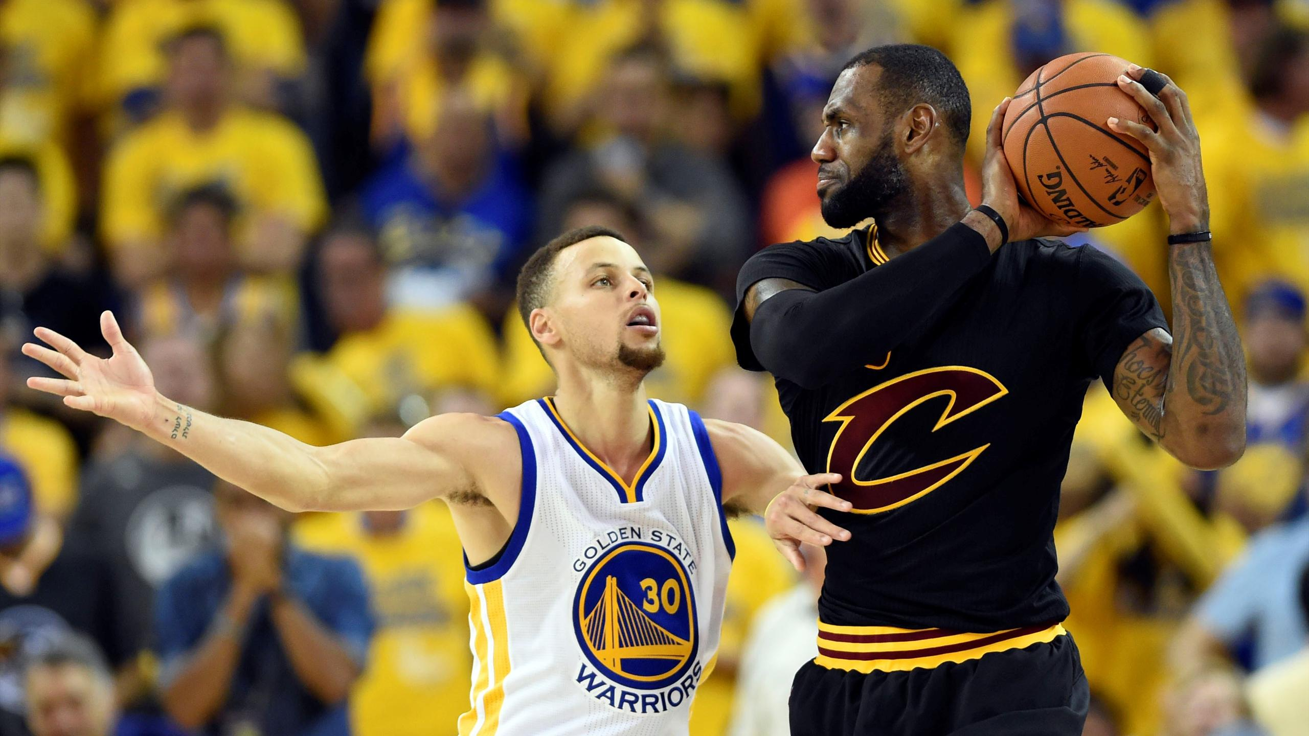 Cleveland Cavaliers forward LeBron James (23) handles the ball against Golden State Warriors guard Stephen Curry (30) during the third quarter in game seven of the NBA Finals at Oracle Arena